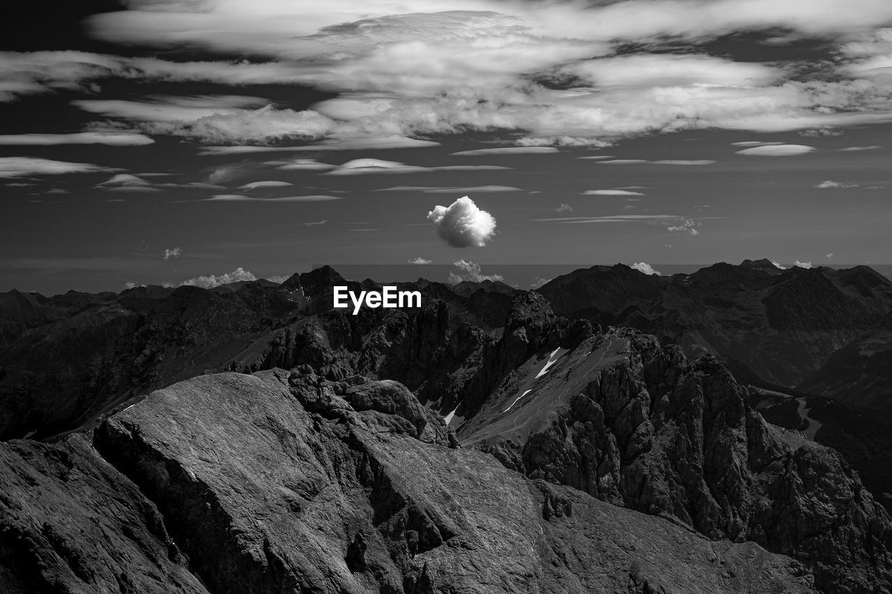 Scenic view of rocks and mountains against sky