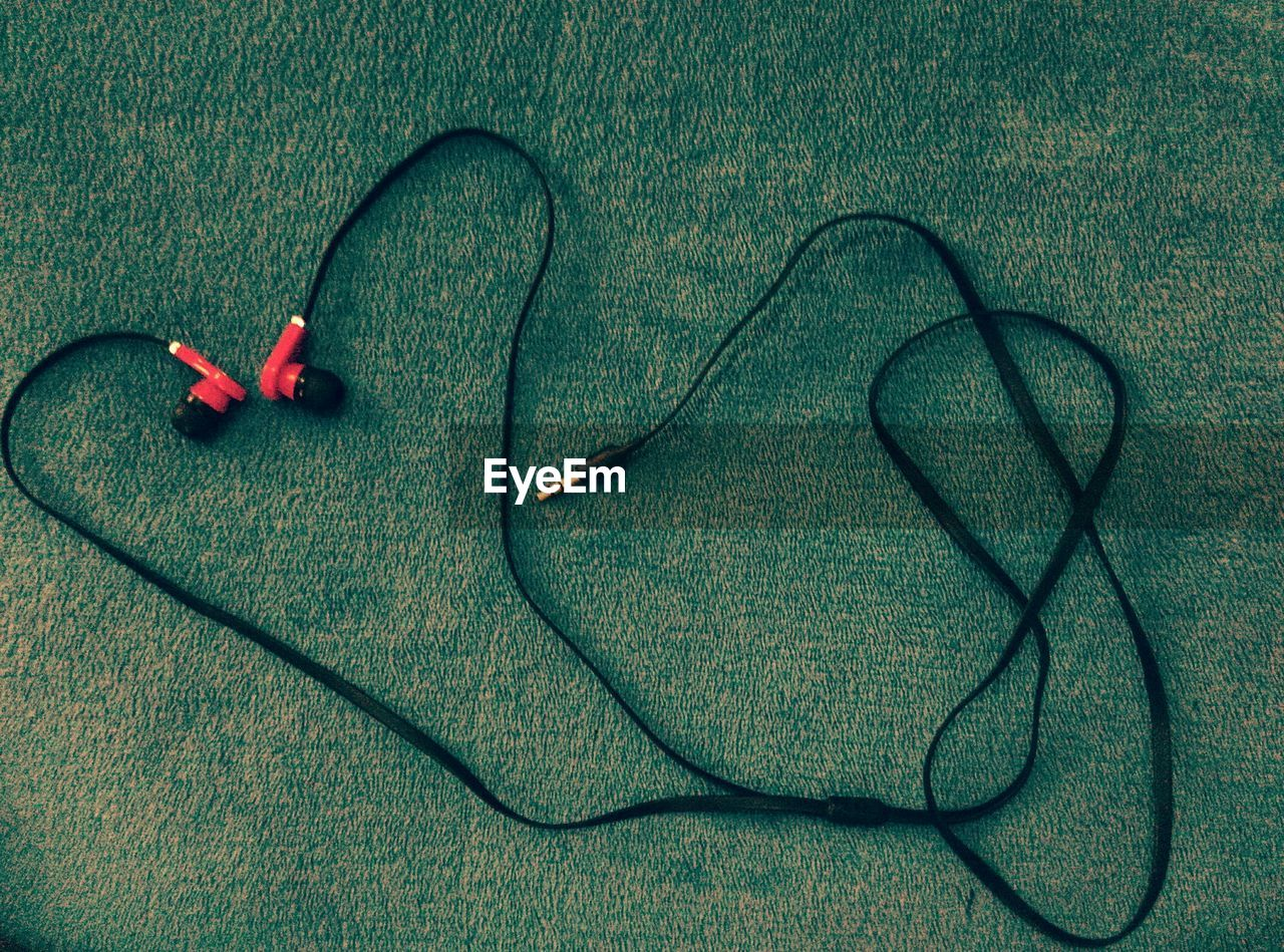 High Angle View Of Earphones On Table