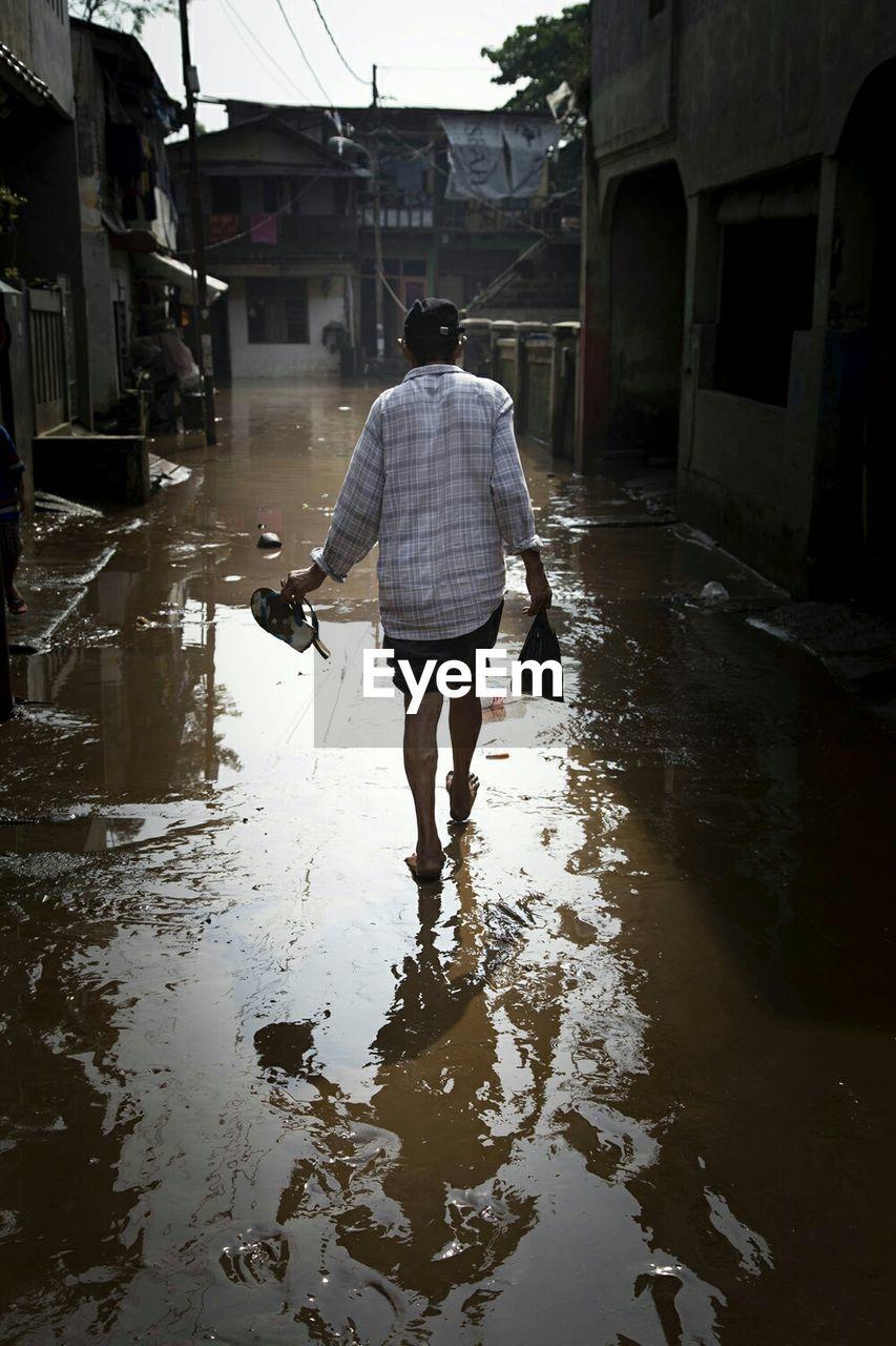 Man On Flooded Street
