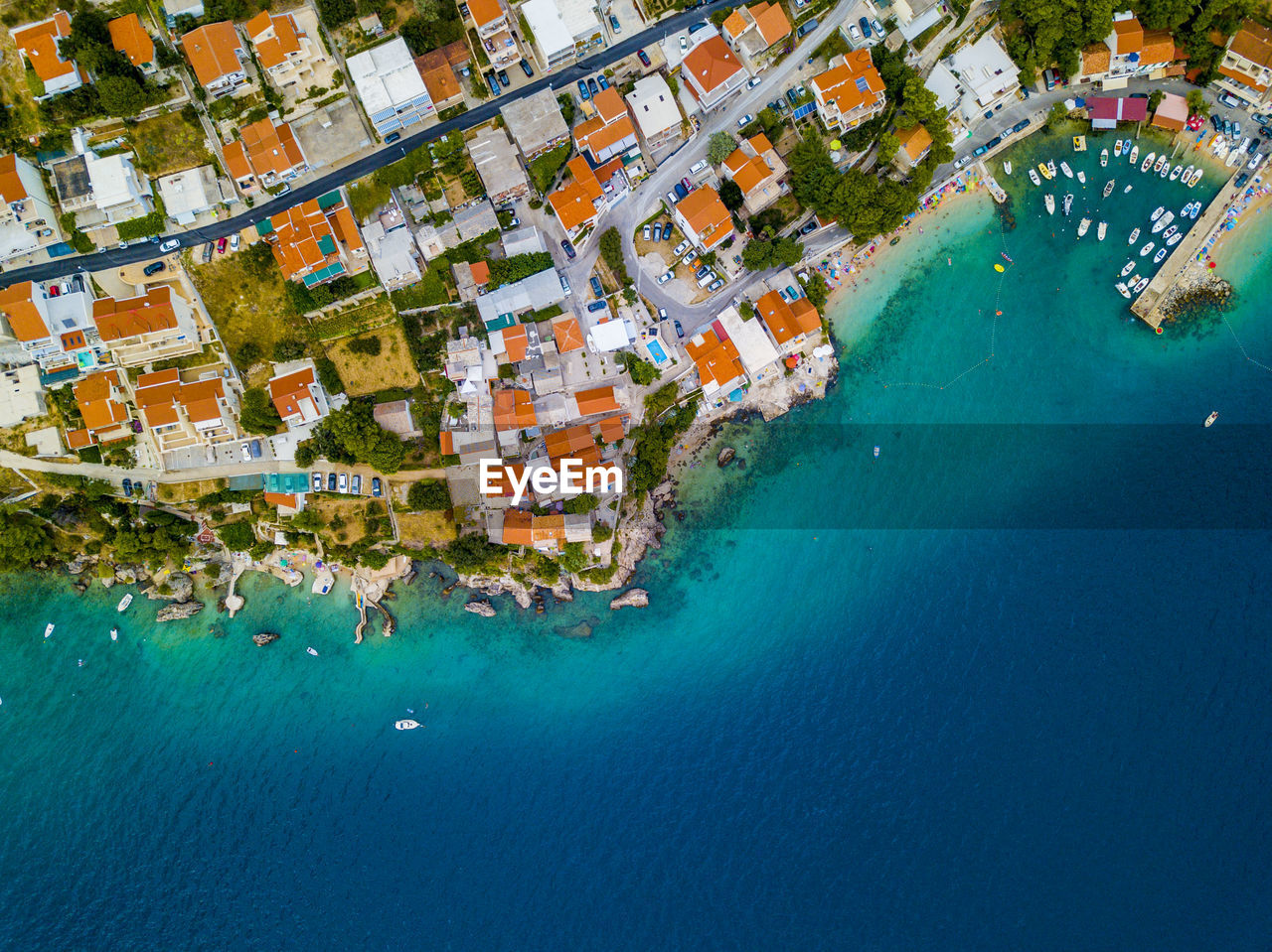Aerial View Of Houses In Town By Sea