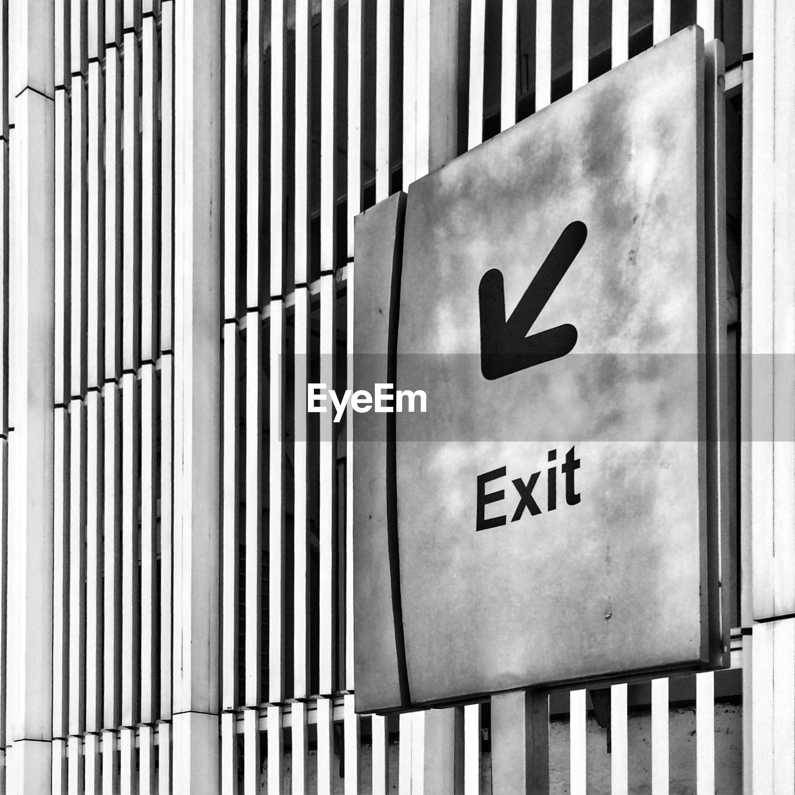 Close-up of exit sign on the wall