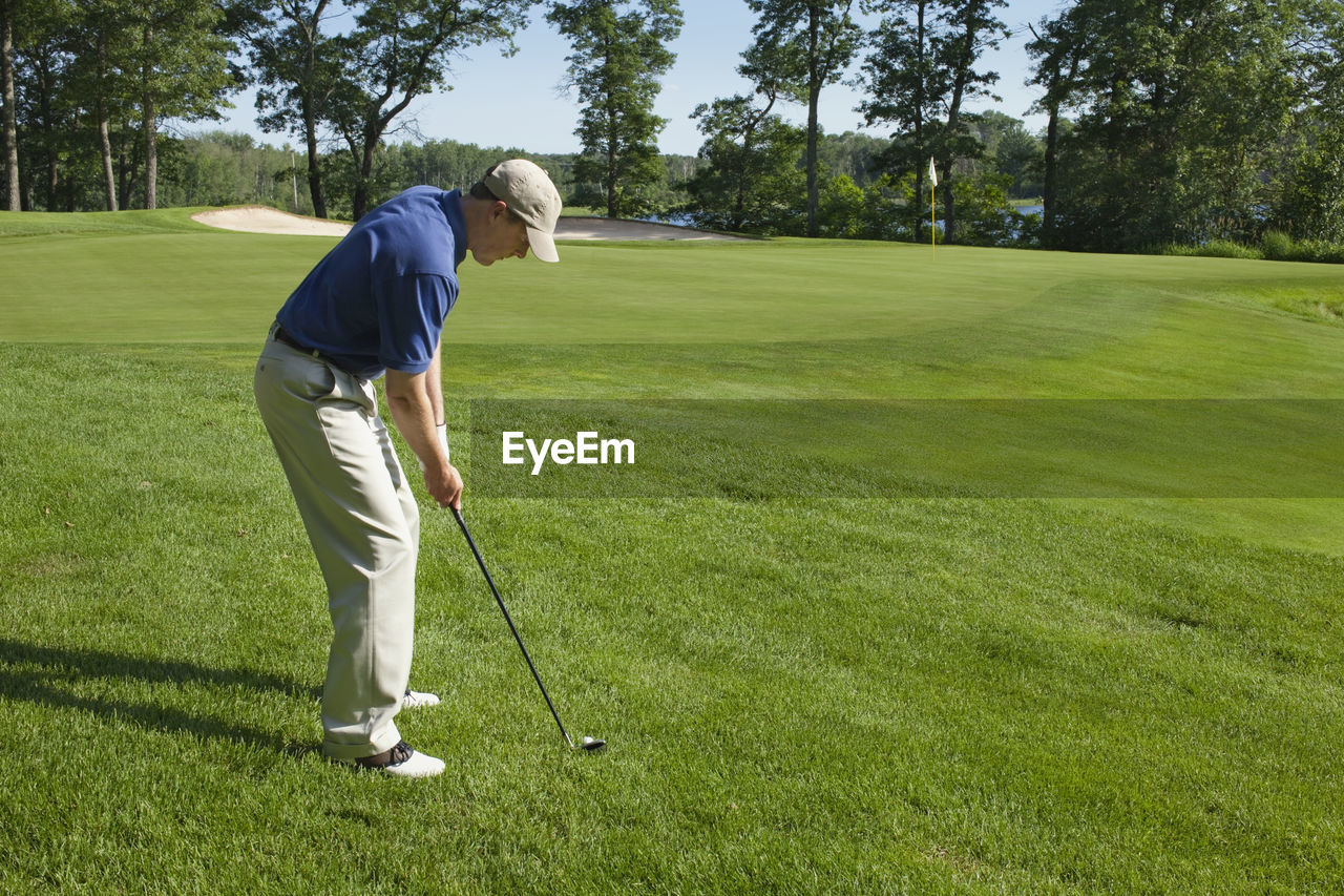 Side View Of Man Playing Golf