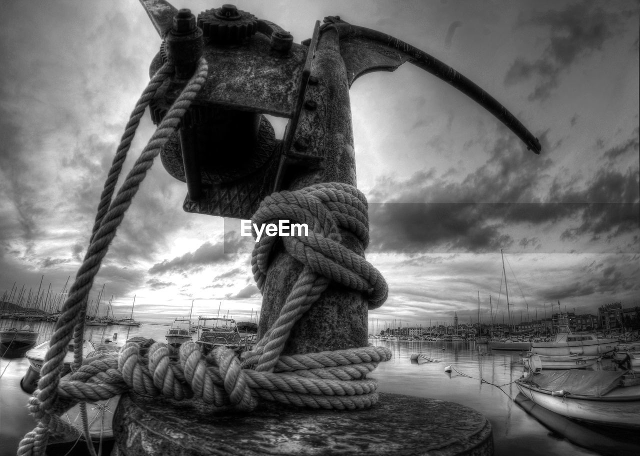 rope, strength, nautical vessel, moored, boat, tied up, harbor, tied knot, sea, sky, cloud - sky, mode of transport, transportation, outdoors, no people, day, cleat, sailing ship
