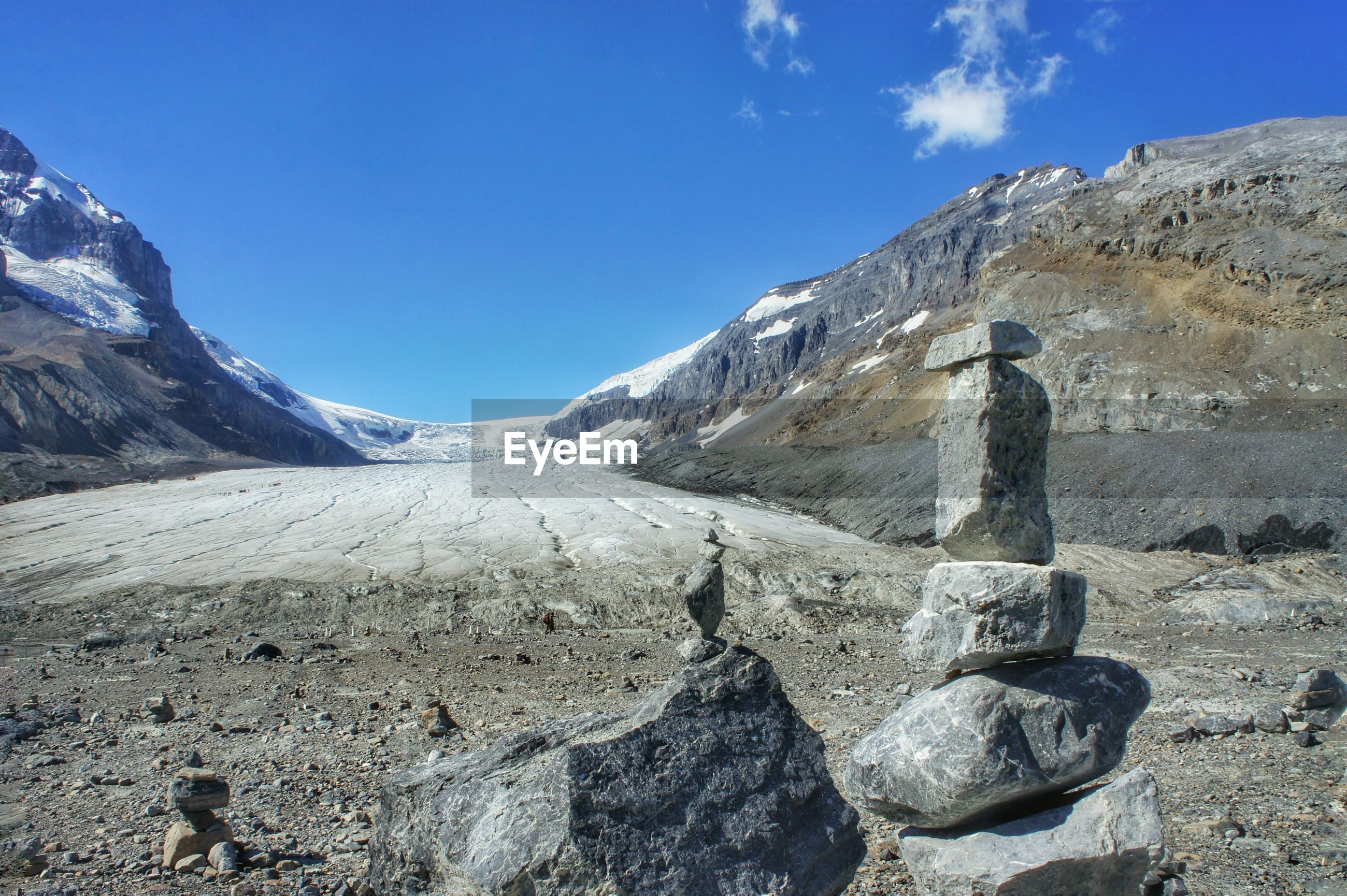 SCENIC VIEW OF MOUNTAIN AGAINST BLUE SKY