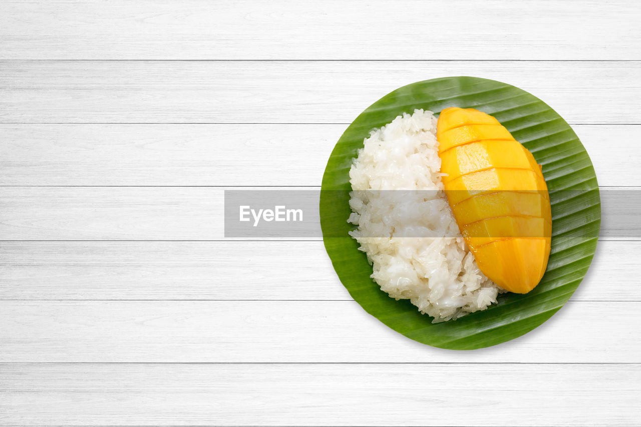 healthy eating, food, still life, food and drink, wellbeing, table, freshness, directly above, rice - food staple, no people, indoors, ready-to-eat, wood - material, rice, asian food, japanese food, high angle view, plate, close-up, leaves