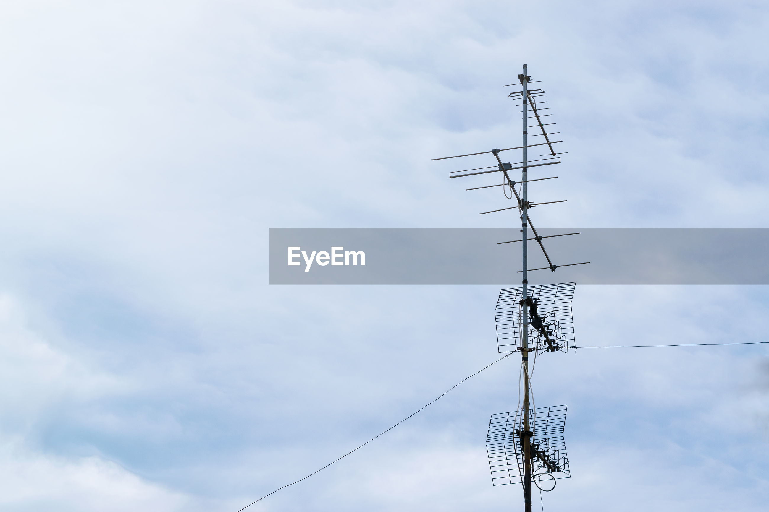 Low angle view of electricity pylon or aerial against sky