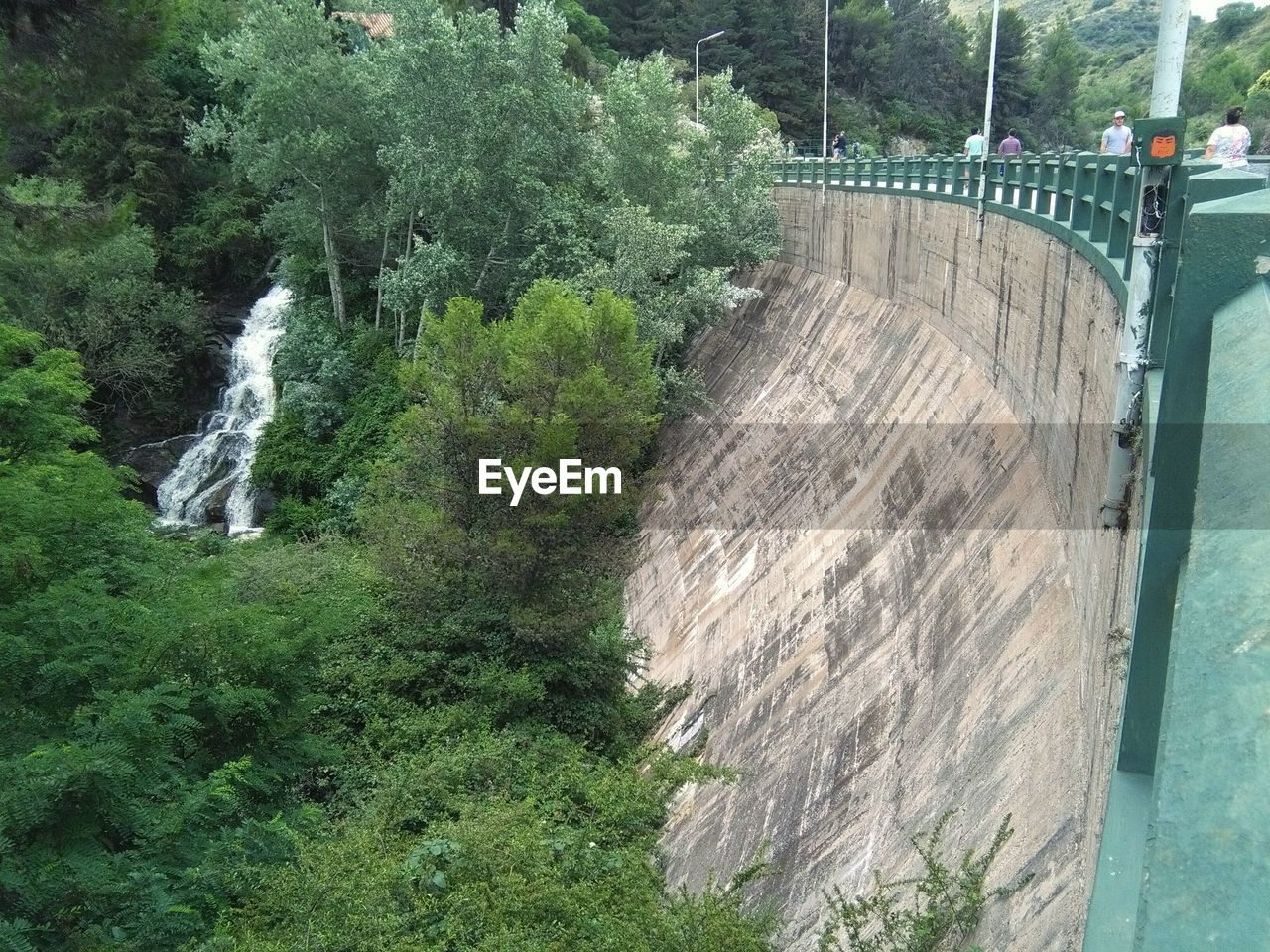High Angle View Of Dam By Waterfall