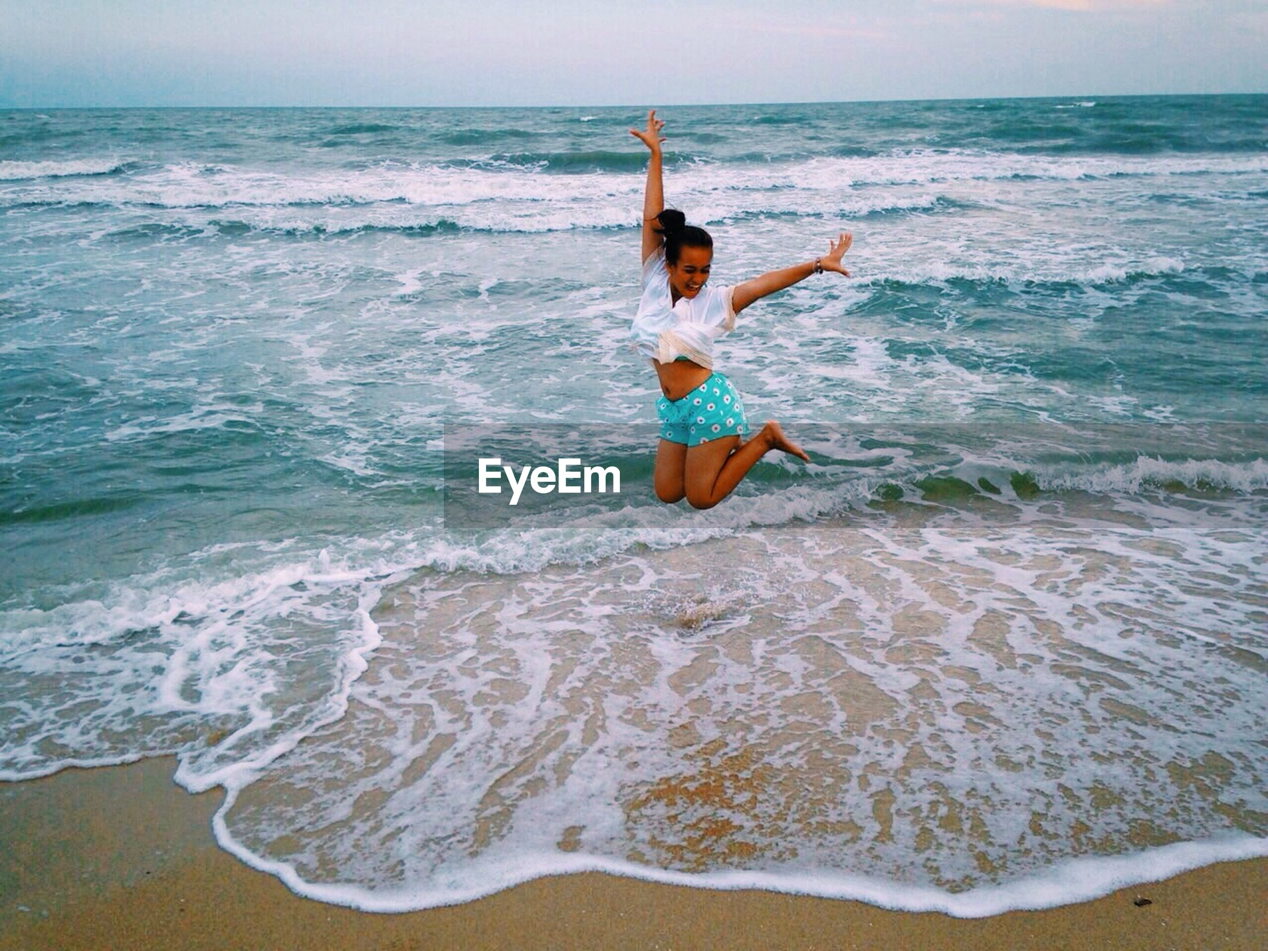 sea, water, horizon over water, beach, wave, full length, motion, leisure activity, shore, surf, mid-air, vacations, lifestyles, jumping, beauty in nature, sand, nature, flying