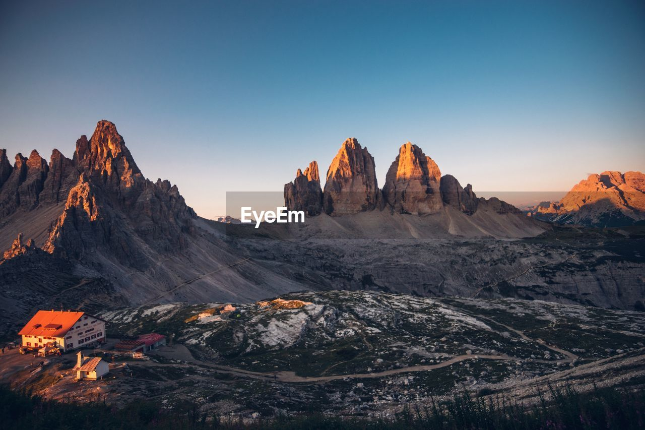 mountain, sky, landscape, environment, beauty in nature, scenics - nature, nature, mountain range, tranquil scene, non-urban scene, tranquility, no people, idyllic, rock, clear sky, outdoors, travel destinations, sunset, formation, geology, mountain peak, range, eroded