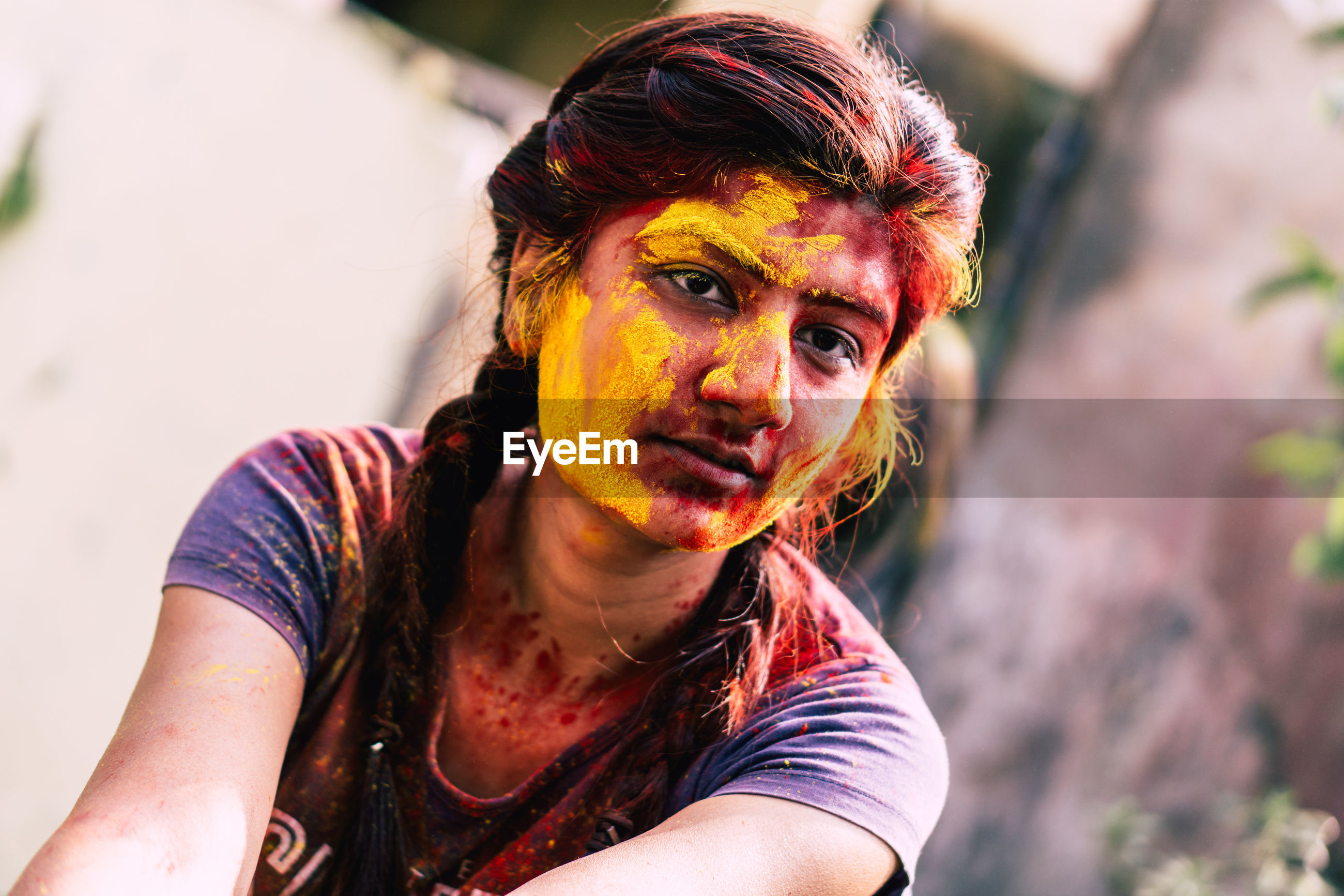 Young woman with powder paint on face during holi
