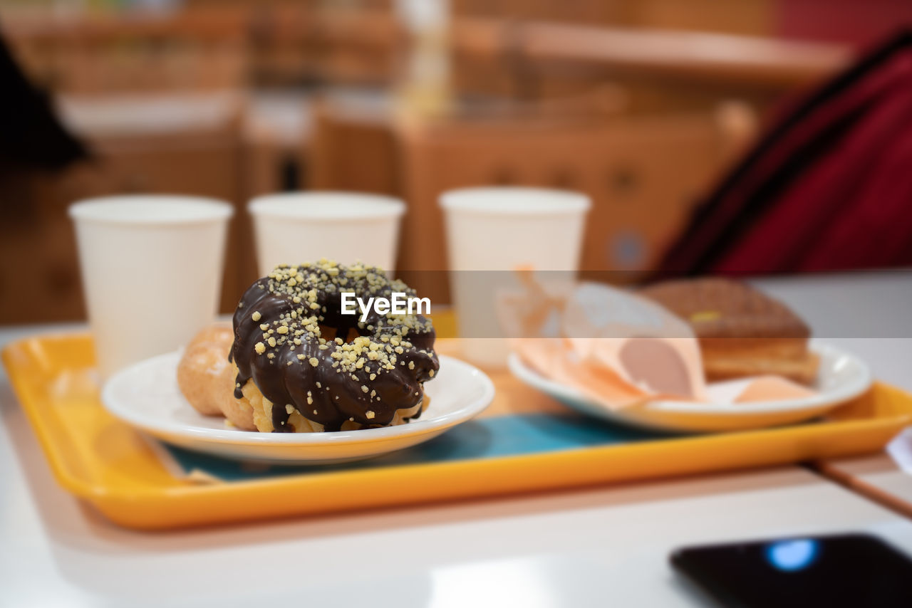 food and drink, plate, food, table, ready-to-eat, freshness, indoors, still life, serving size, no people, close-up, indulgence, focus on foreground, sweet food, selective focus, unhealthy eating, sweet, temptation, dessert, snack