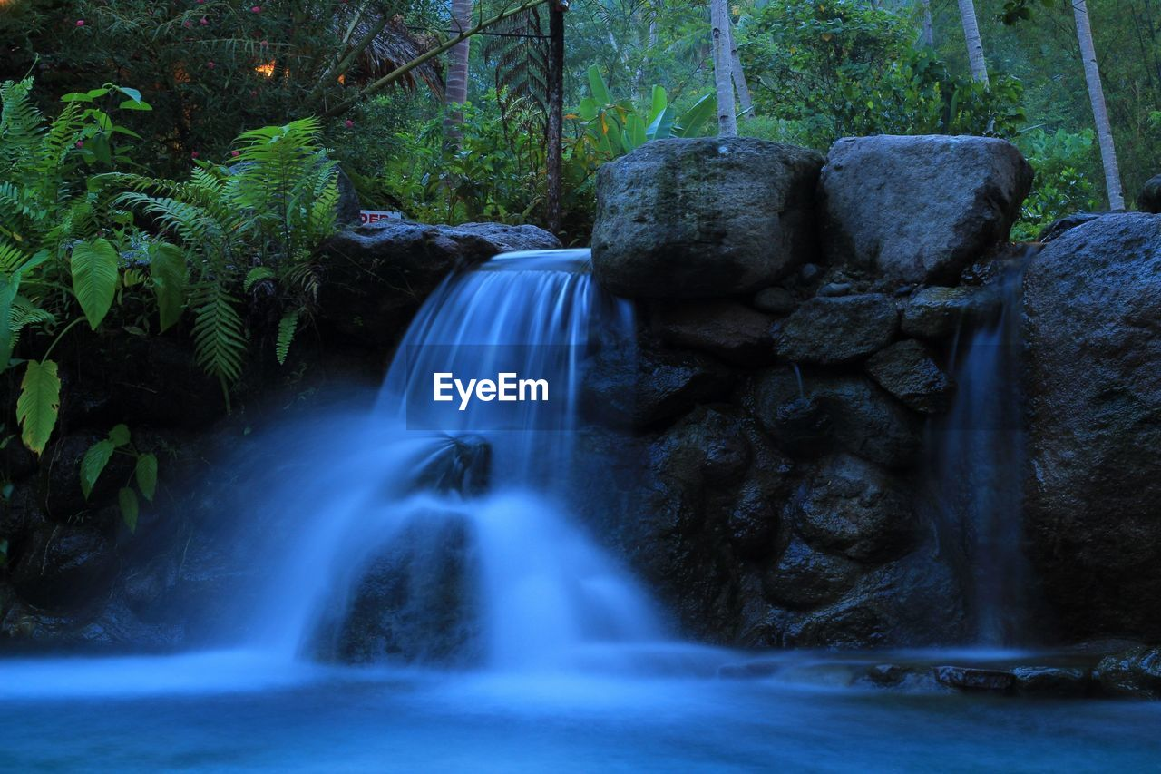 Long exposure of waterfall in forest