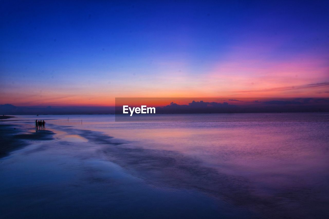 sky, sunset, water, scenics - nature, sea, beauty in nature, tranquil scene, tranquility, orange color, cloud - sky, idyllic, horizon, horizon over water, blue, nature, beach, no people, waterfront, reflection, purple, romantic sky