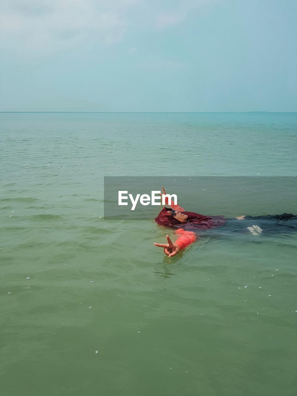 PERSON IN SEA