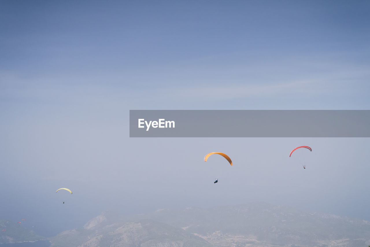 People Paragliding Against Clear Sky
