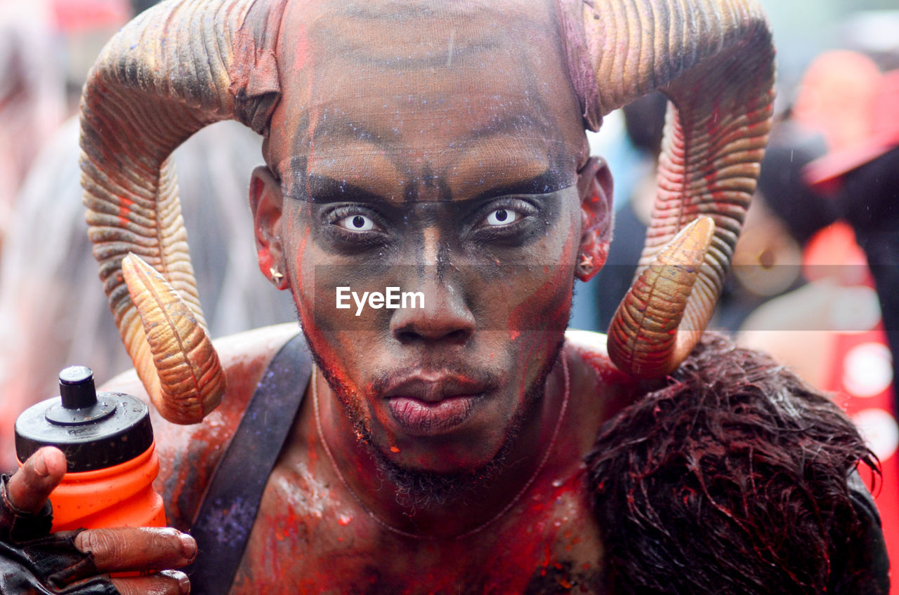 Close-up portrait of man in spooky make-up during carnival