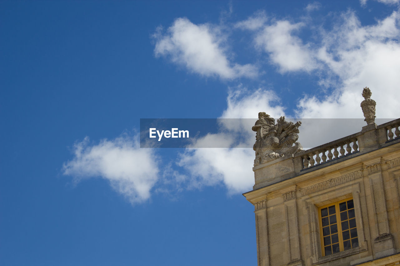 Low Angle View Of Chateau De Versailles Against Sky