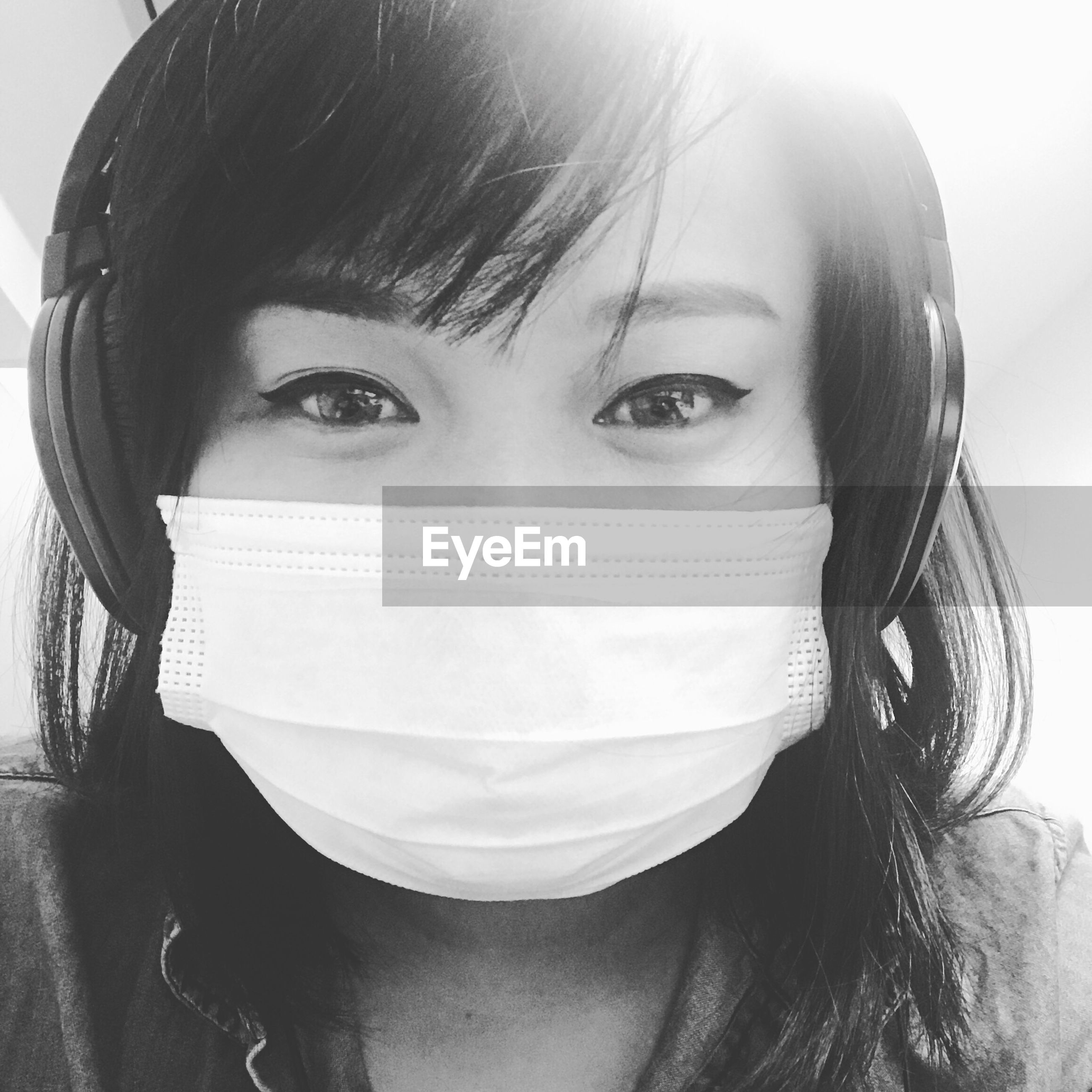 Close-up portrait of young woman wearing surgical mask