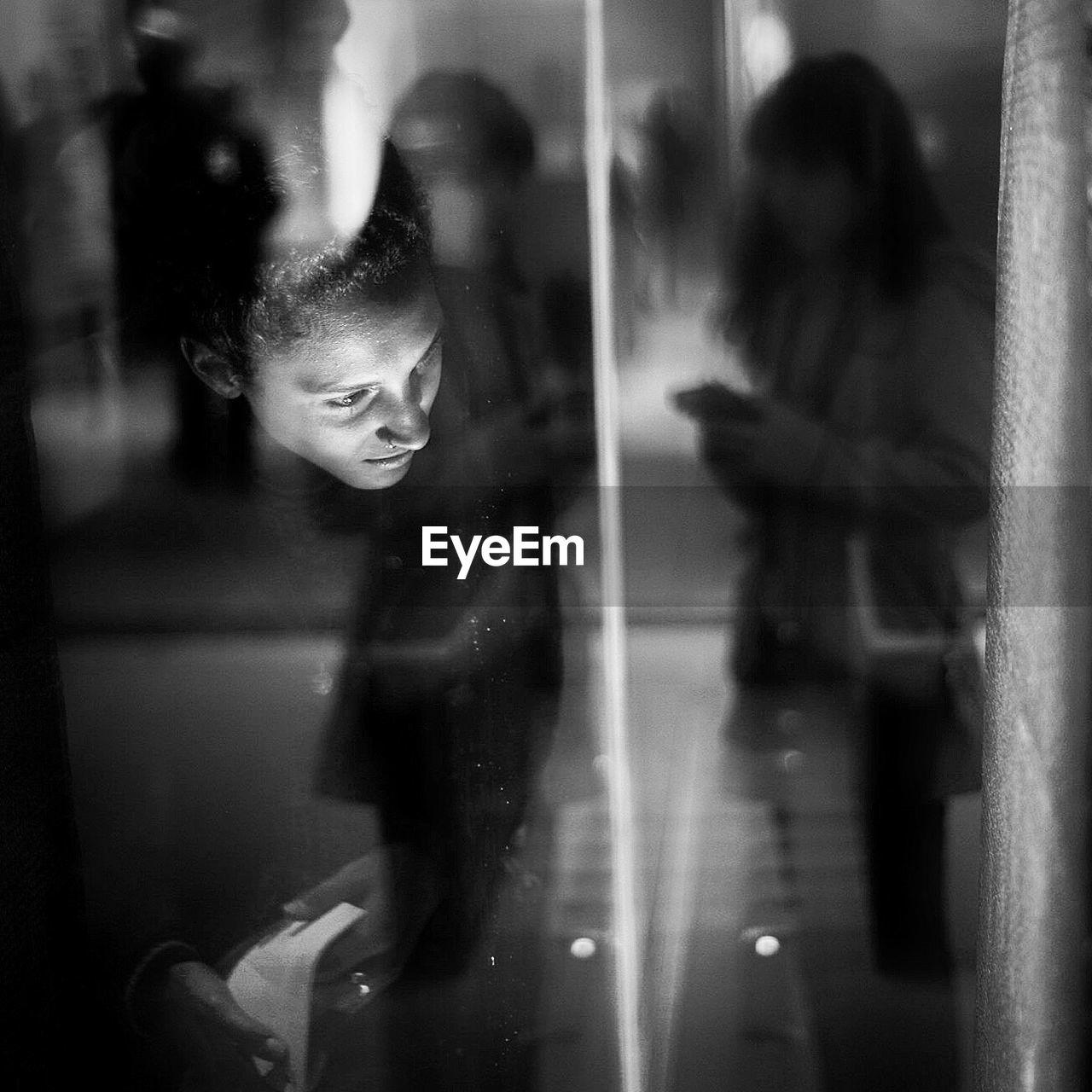 Woman Seen Through Glass