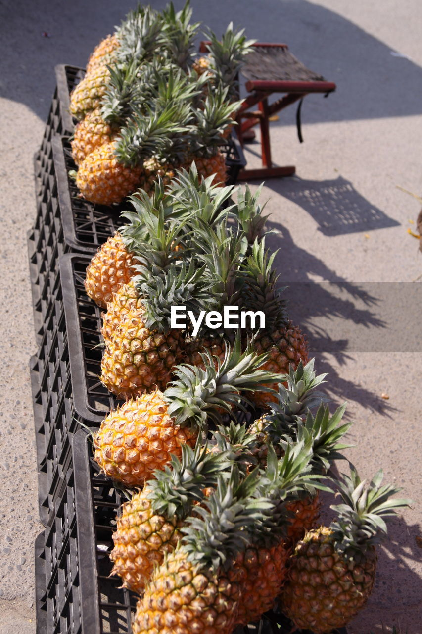 high angle view, food and drink, no people, pineapple, sunlight, freshness, food, day, fruit, healthy eating, outdoors, close-up