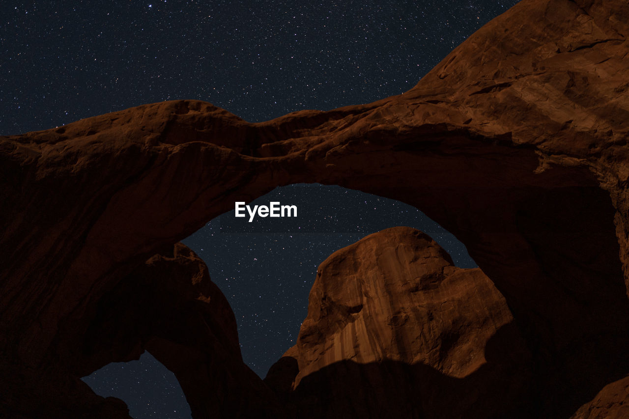 Low Angle View Of Rock Formations At Night