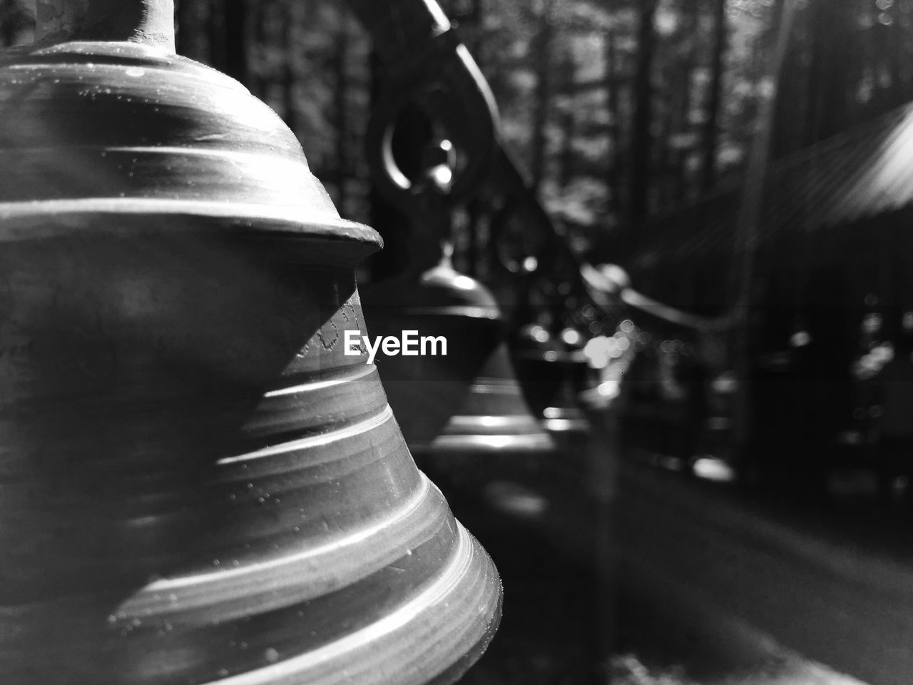 Close-Up Of Metallic Bells At Temple