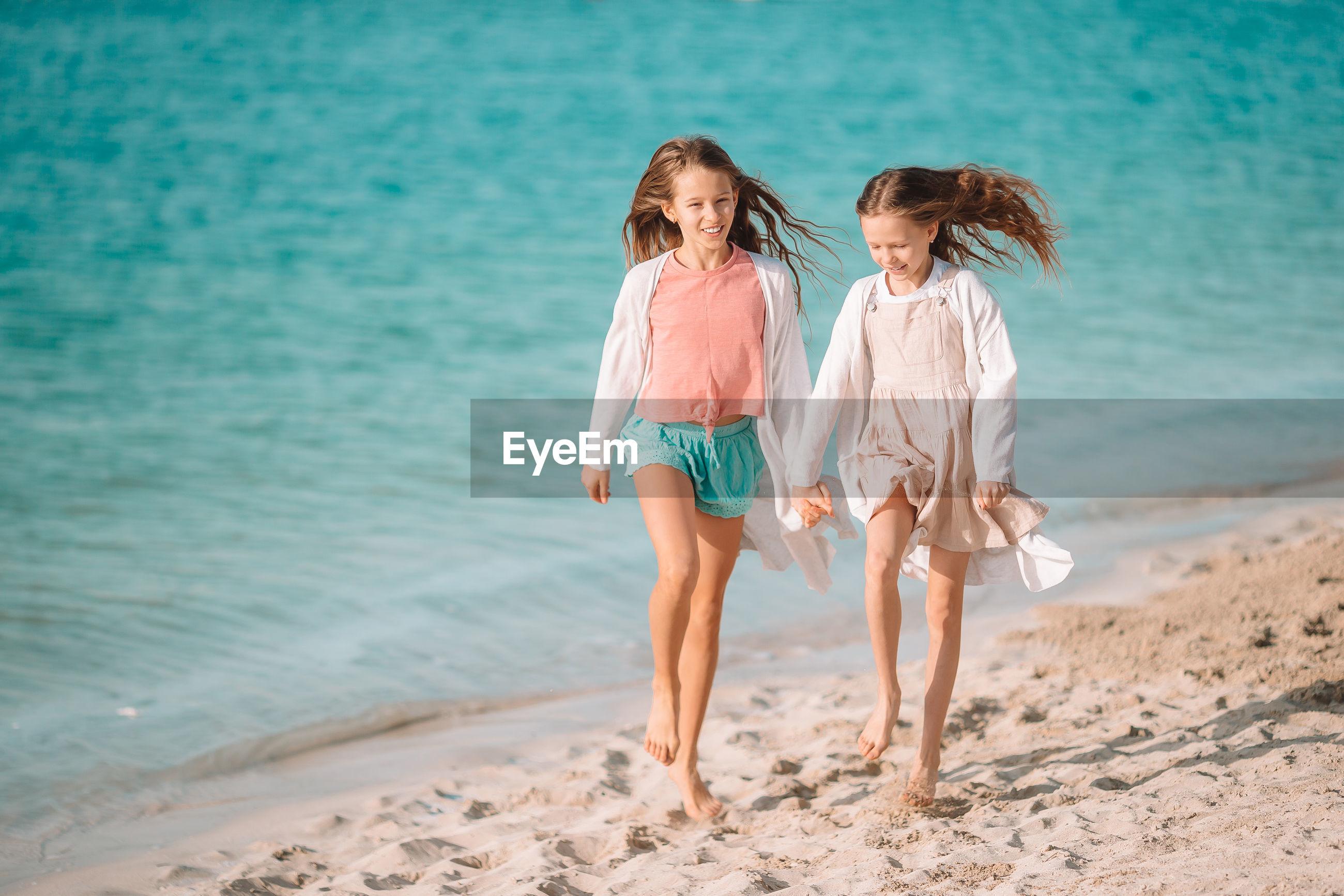 FULL LENGTH OF MOTHER ON BEACH