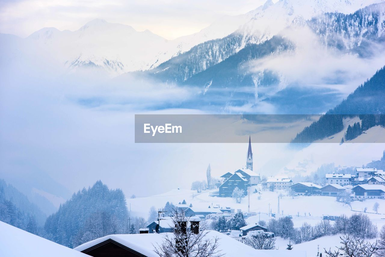 winter, snow, cold temperature, mountain, architecture, scenics - nature, beauty in nature, sky, nature, built structure, building exterior, environment, building, mountain range, cloud - sky, landscape, covering, religion, white color, no people, snowcapped mountain, outdoors