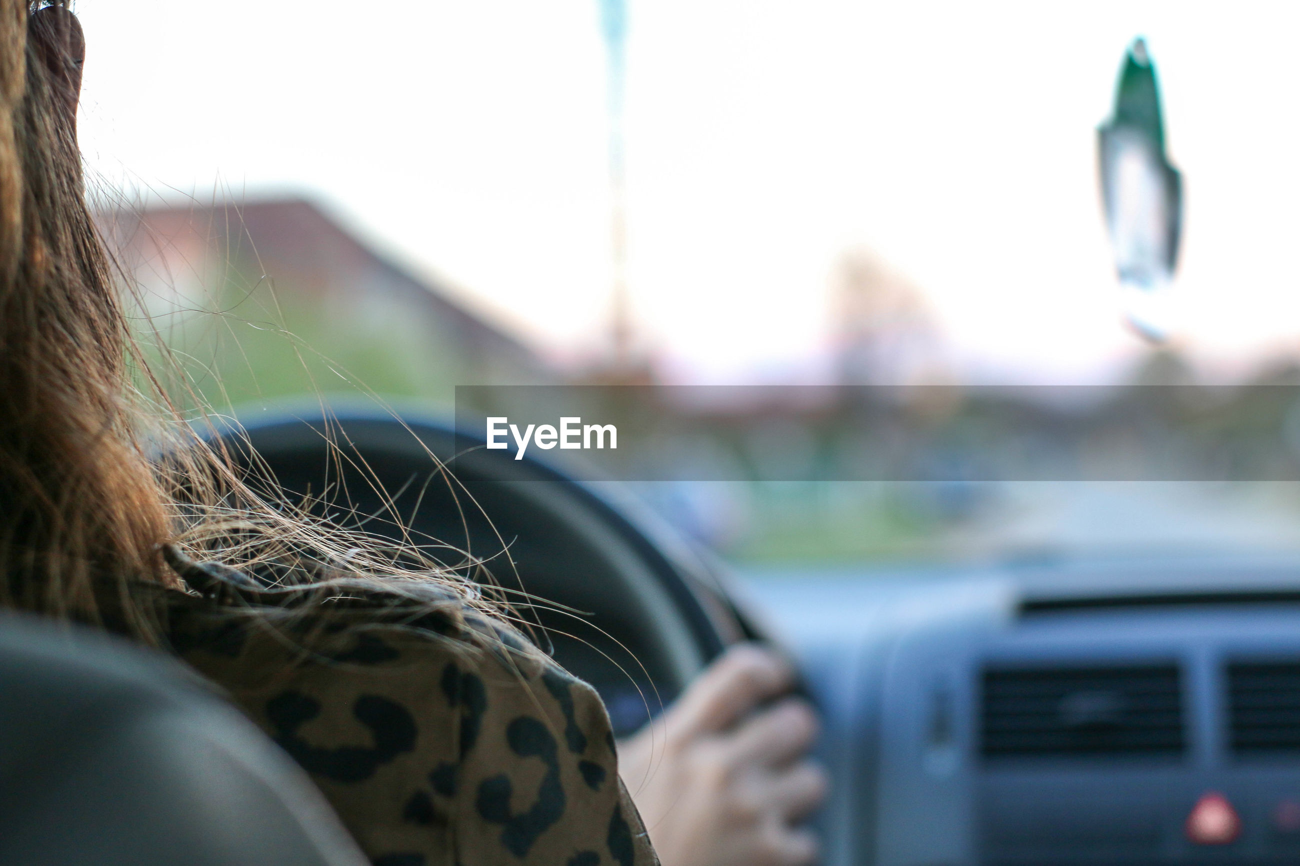 Close-up of woman driving in car