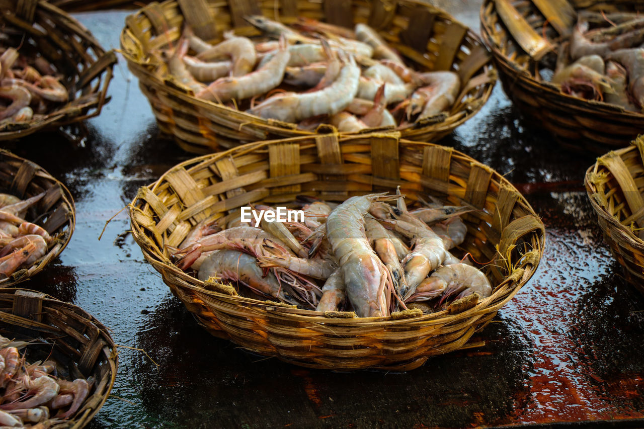 food and drink, food, basket, freshness, container, seafood, still life, wellbeing, wicker, no people, for sale, high angle view, healthy eating, retail, day, focus on foreground, indoors, large group of objects, fish, market