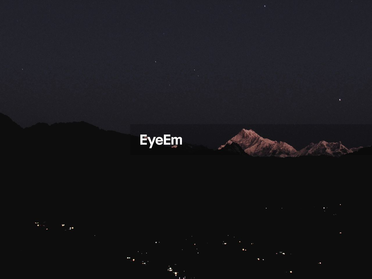 mountain, scenics, beauty in nature, tranquility, nature, volcano, night, no people, outdoors, tranquil scene, mountain range, silhouette, landscape, sky, lava, clear sky