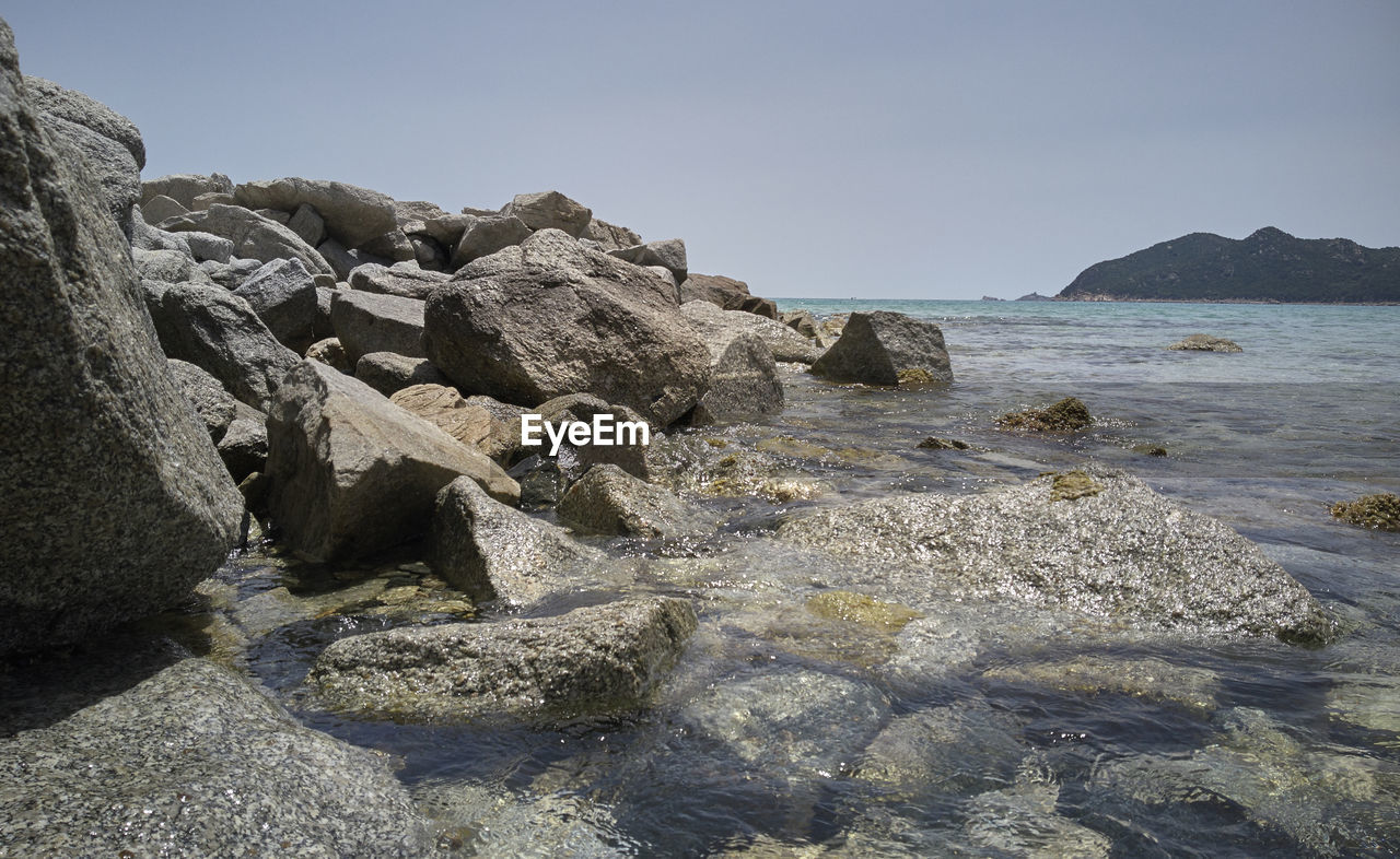 rock, sky, water, sea, rock - object, solid, beauty in nature, nature, land, beach, scenics - nature, tranquility, day, clear sky, no people, tranquil scene, rock formation, outdoors, motion, rocky coastline, flowing water