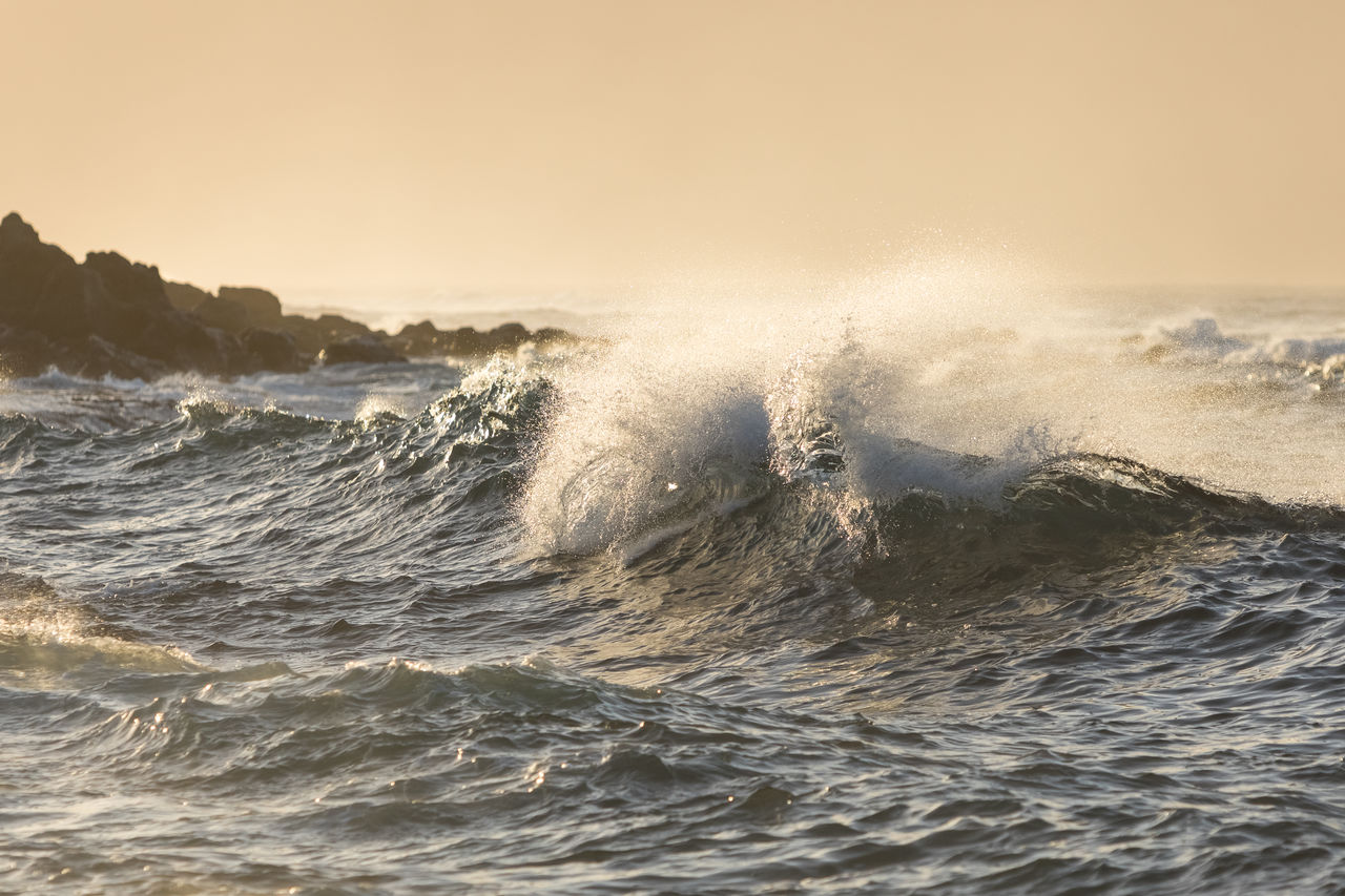 sea, motion, wave, water, sky, waterfront, power in nature, power, beauty in nature, splashing, nature, clear sky, sport, scenics - nature, outdoors, no people, aquatic sport, sunset, day, horizon over water, breaking