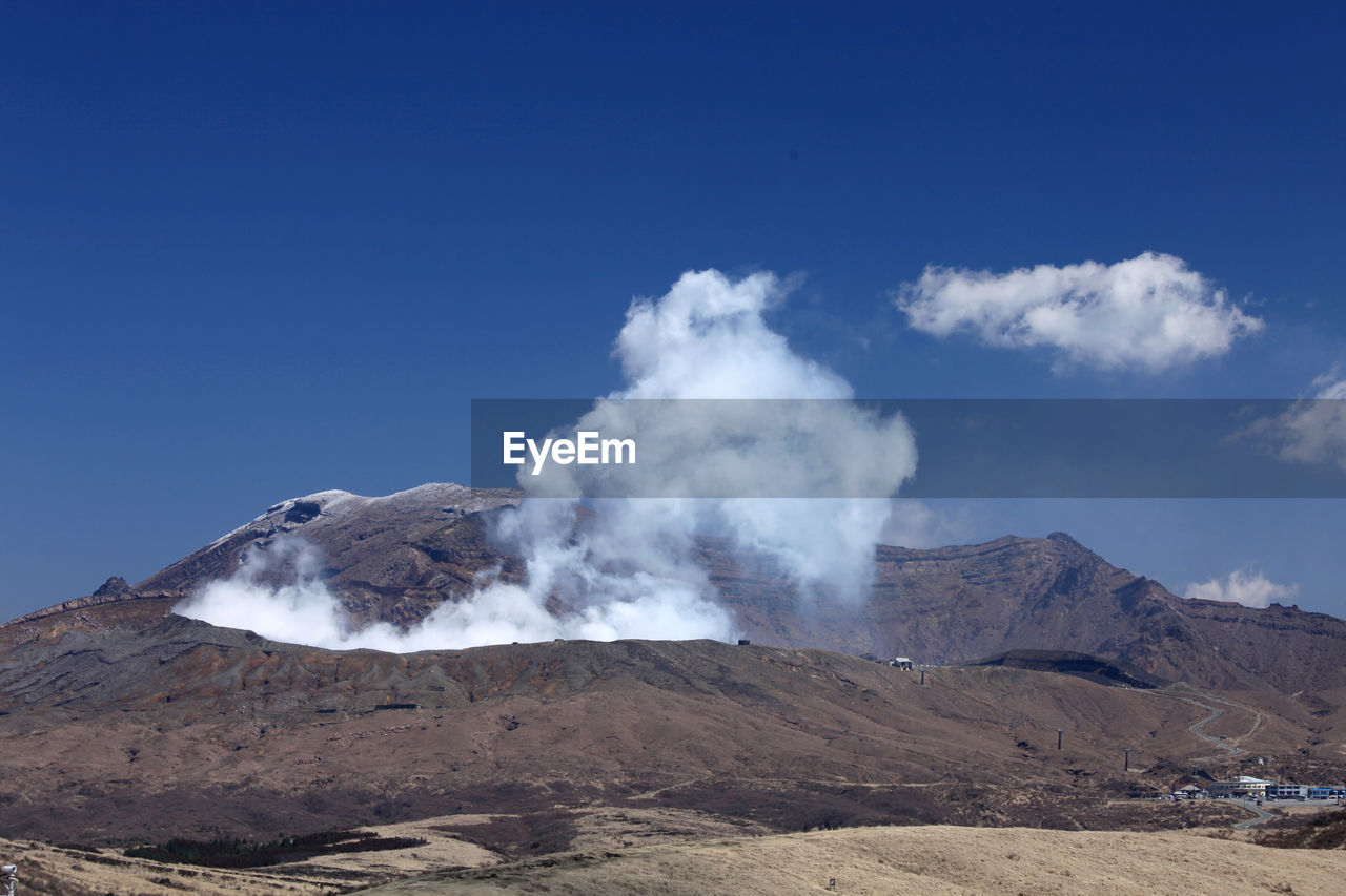 mountain, sky, scenics - nature, beauty in nature, landscape, non-urban scene, smoke - physical structure, tranquil scene, environment, volcano, physical geography, nature, day, blue, no people, geology, tranquility, land, idyllic, remote, power in nature, outdoors, volcanic crater, arid climate, formation