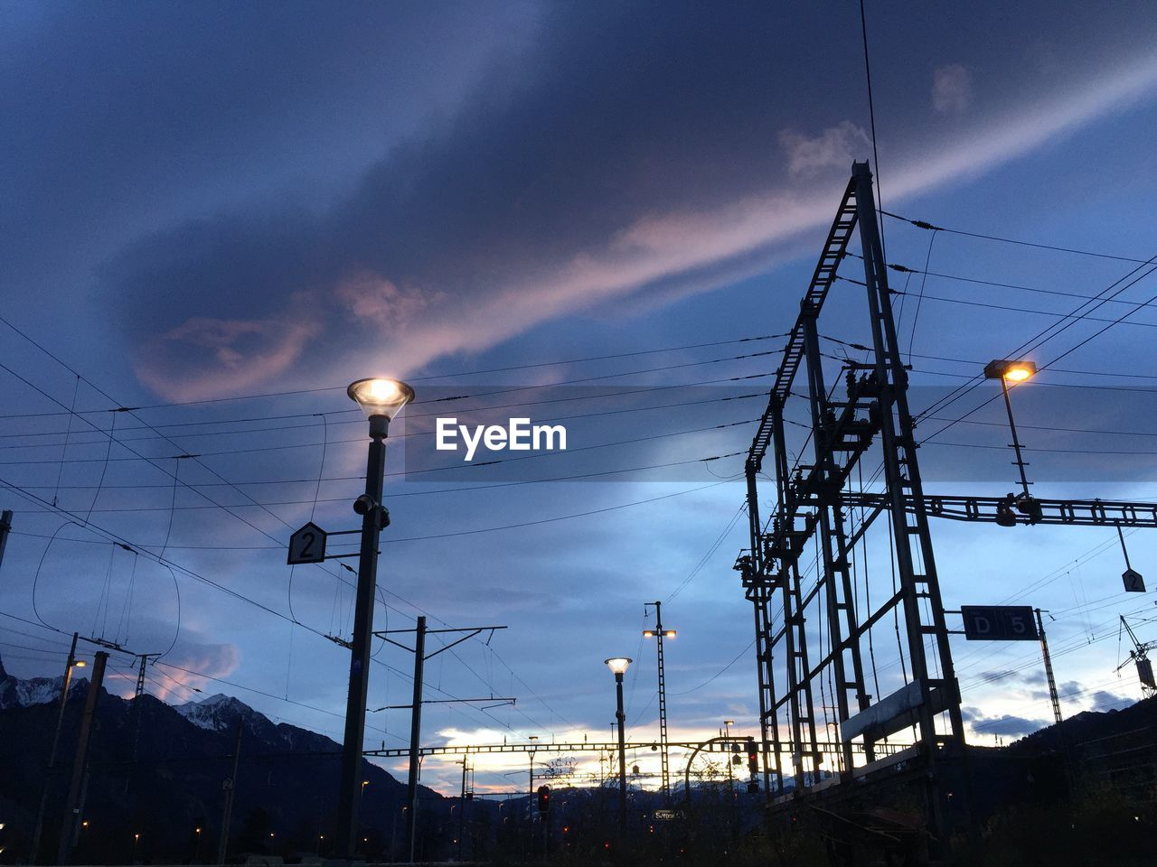sky, electricity, illuminated, lighting equipment, technology, cloud - sky, cable, low angle view, nature, dusk, no people, fuel and power generation, architecture, street light, connection, built structure, electricity pylon, power line, street, outdoors, power supply, light, electrical equipment