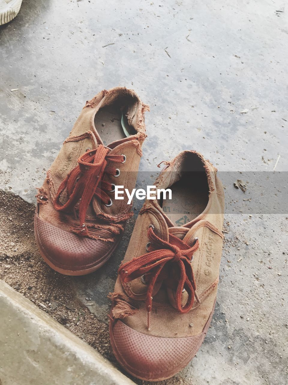 High angle view of weathered shoes