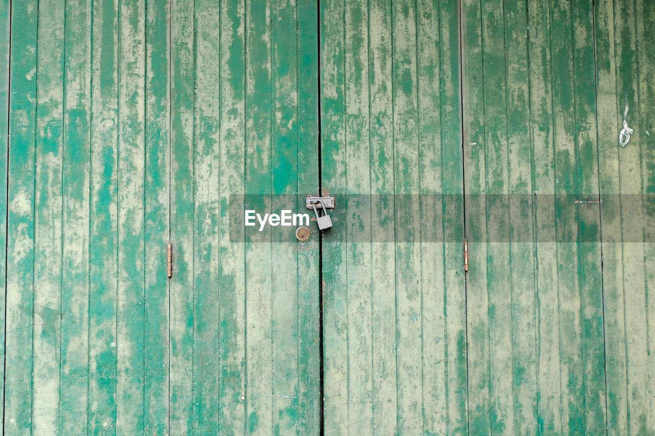 Full Frame Shot Of Old Green Wooden Door