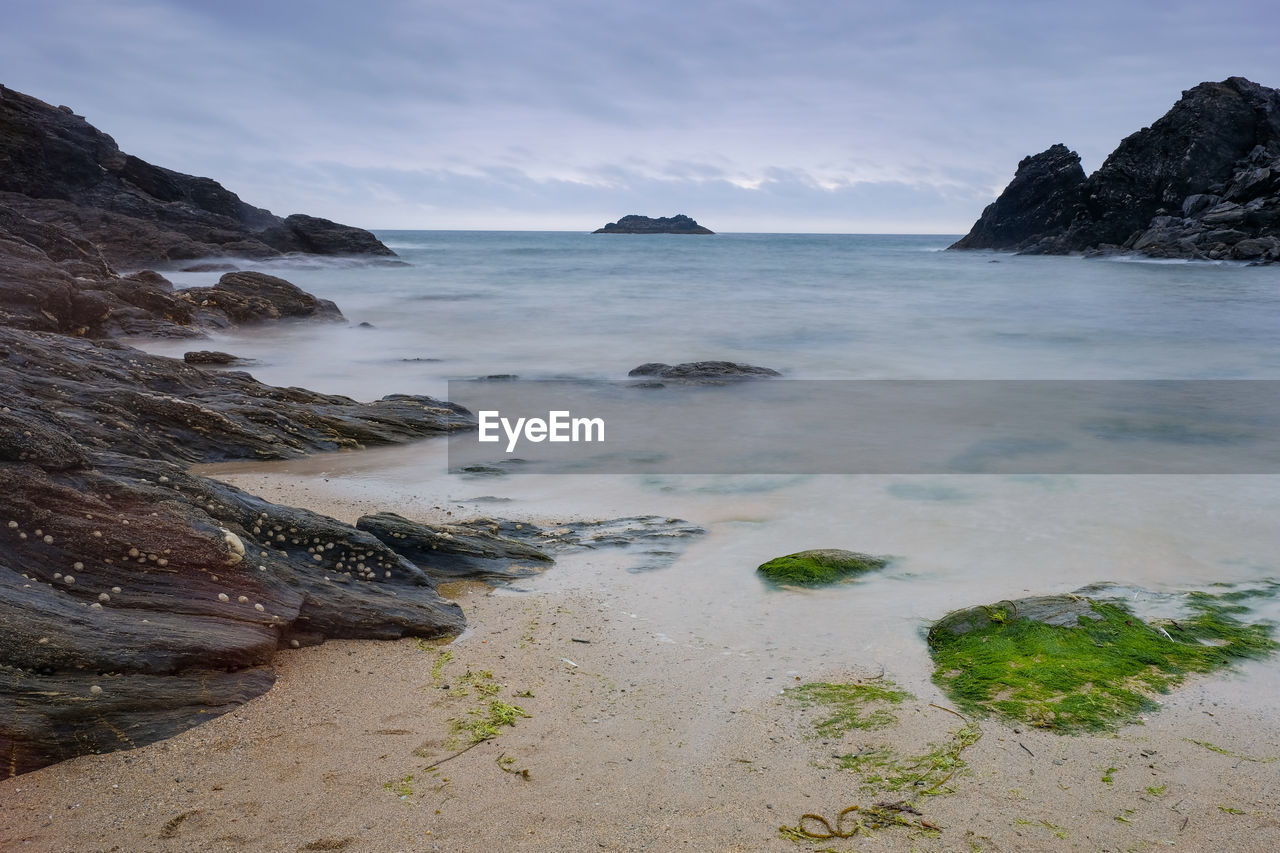 sea, sky, water, beauty in nature, rock, scenics - nature, rock - object, beach, solid, land, tranquil scene, tranquility, no people, nature, horizon over water, horizon, rock formation, cloud - sky, non-urban scene, outdoors, rocky coastline, shallow