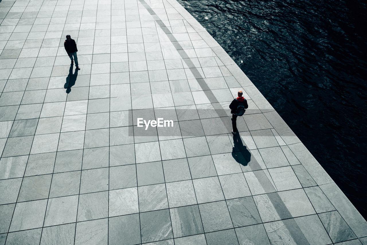 High Angle View Of Men Walking On Promenade