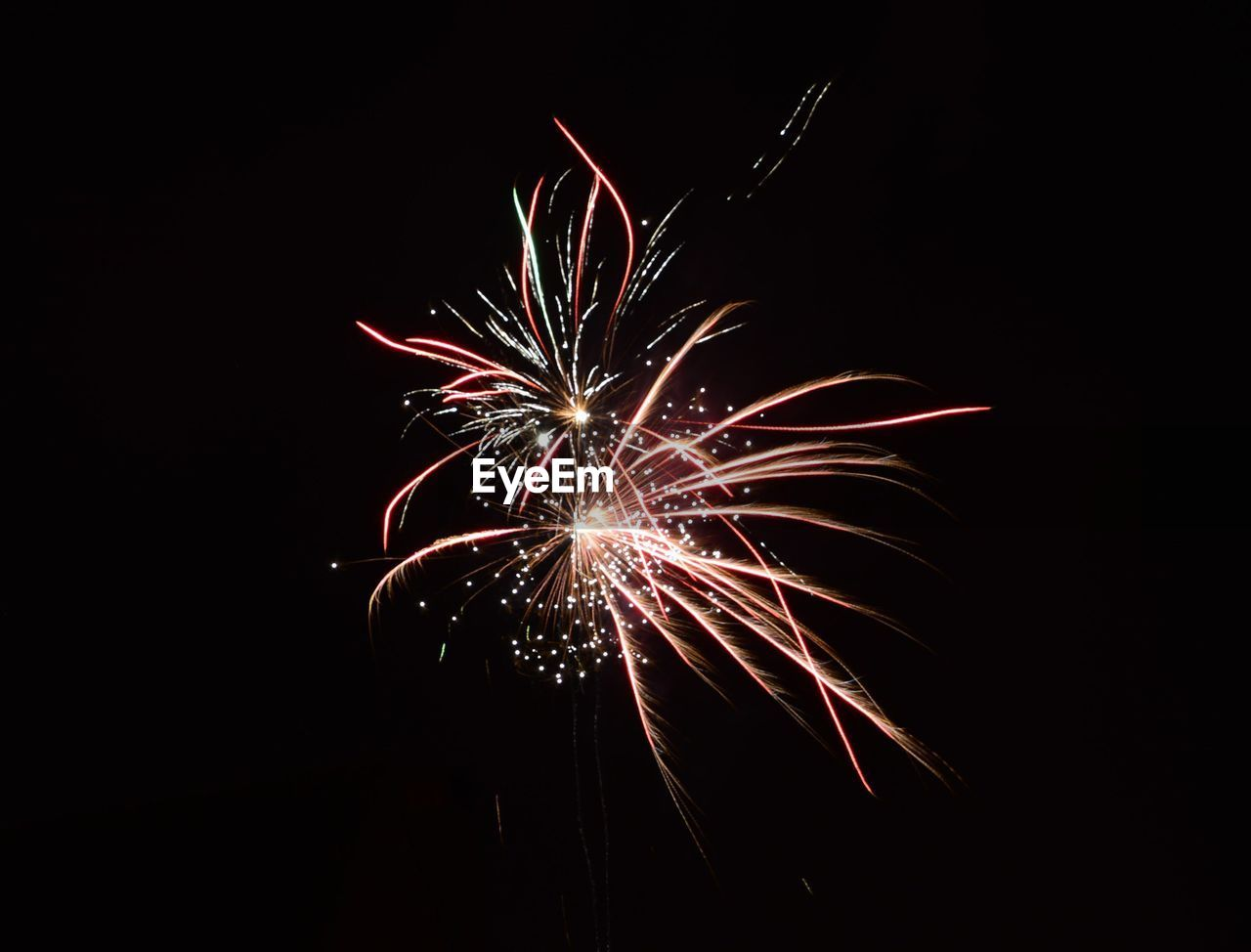 firework display, celebration, firework - man made object, night, exploding, arts culture and entertainment, long exposure, low angle view, motion, illuminated, glowing, event, no people, multi colored, blurred motion, firework, outdoors, sky, clear sky