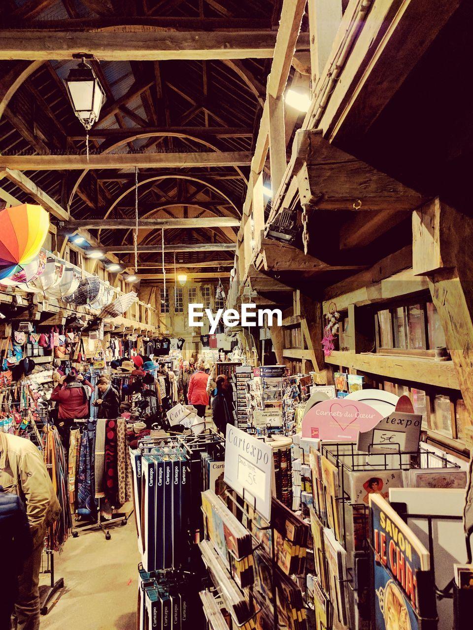 market, indoors, real people, illuminated, architecture, day