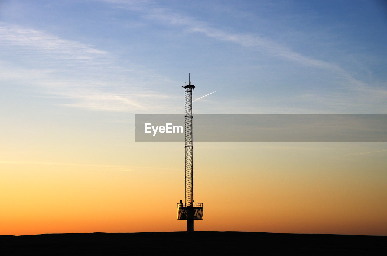 sky, sunset, cloud - sky, nature, orange color, no people, beauty in nature, silhouette, technology, scenics - nature, tower, outdoors, tall - high, communication, low angle view, tranquil scene, tranquility, idyllic, sunlight