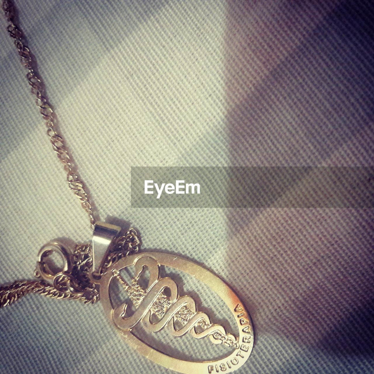 pendant, close-up, indoors, no people, locket, day