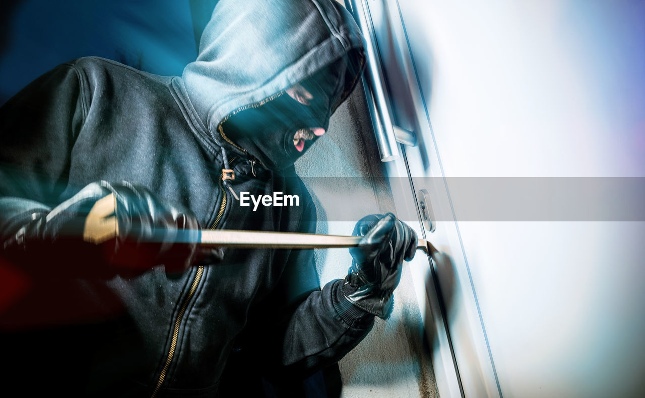 Close-Up Of Man Breaking Into Home