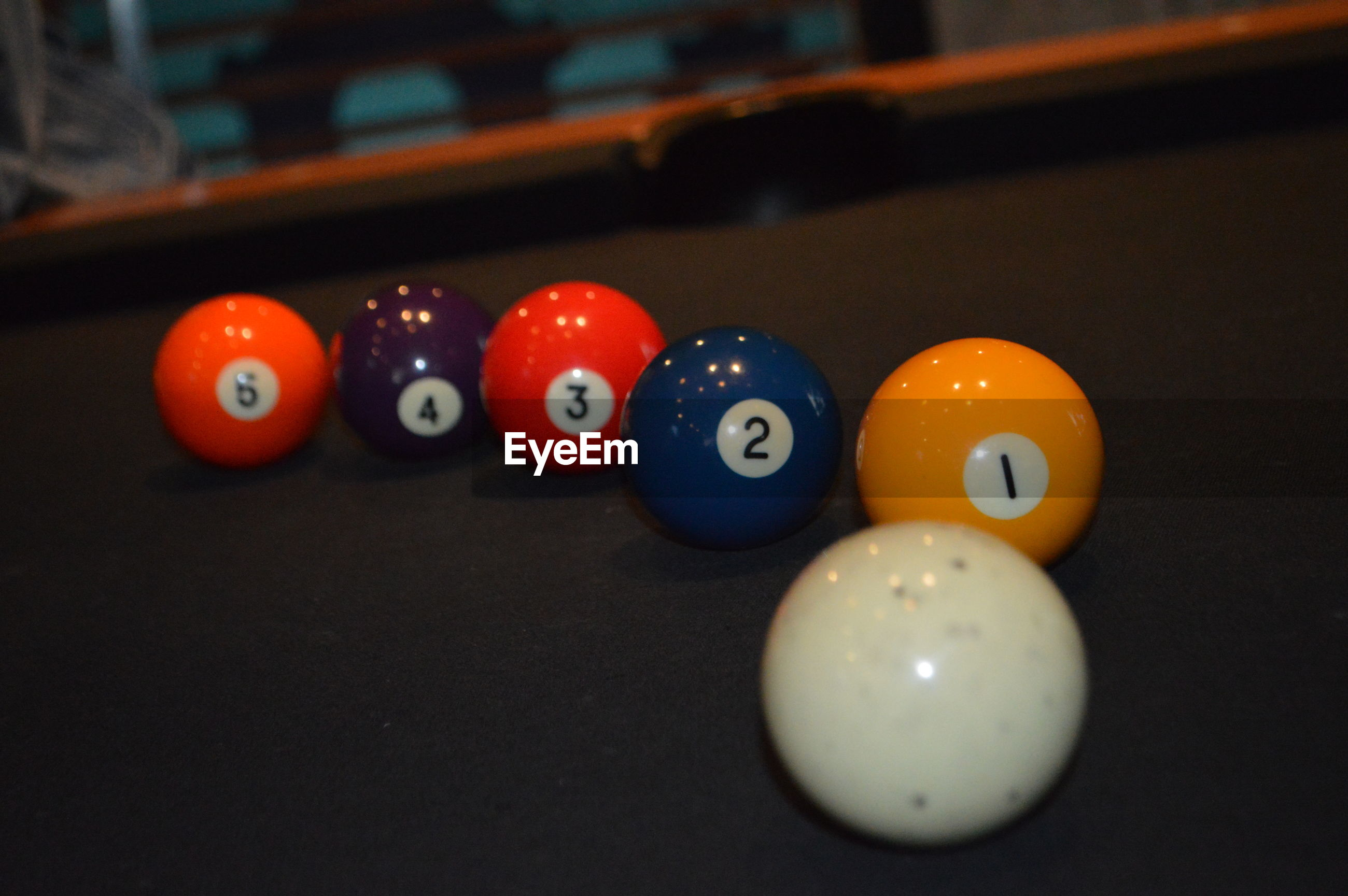 CLOSE-UP OF MULTI COLORED BALL ON TABLE AT HOME