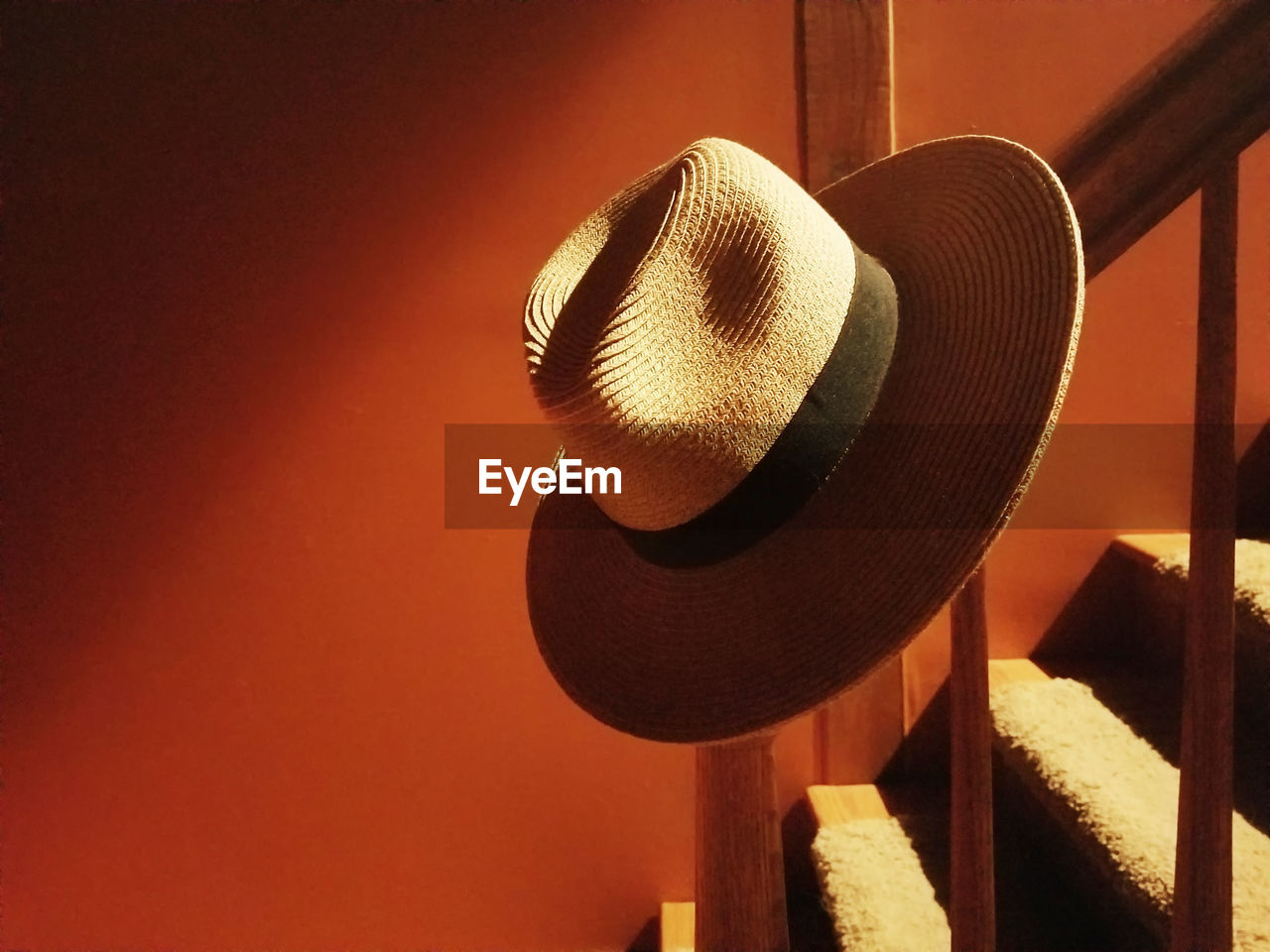 Close-up of hat on railing at home