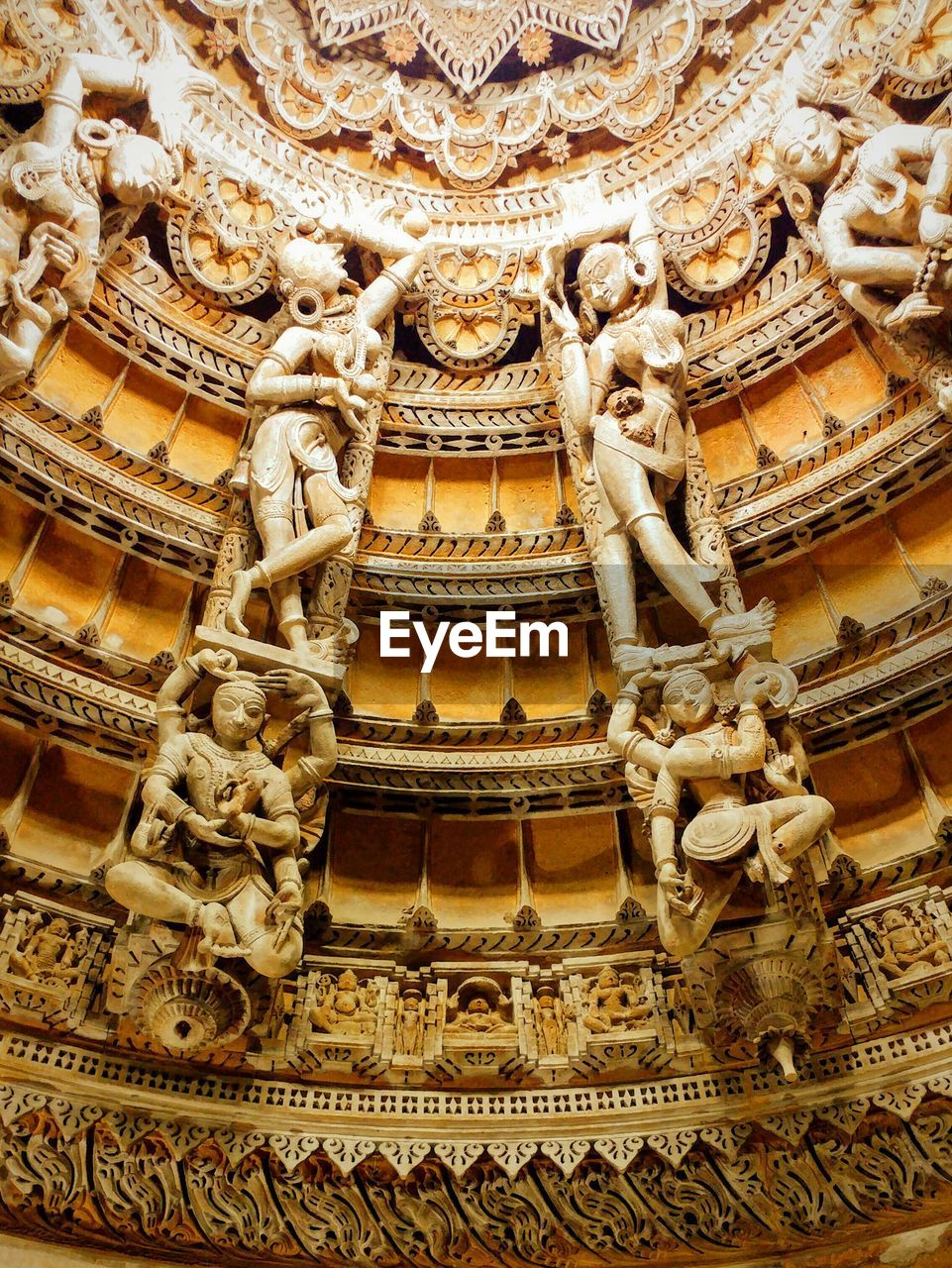 ornate, religion, architecture, art and craft, low angle view, spirituality, carving - craft product, place of worship, history, building exterior, statue, sculpture, travel destinations, bas relief, built structure, no people, day, outdoors, close-up