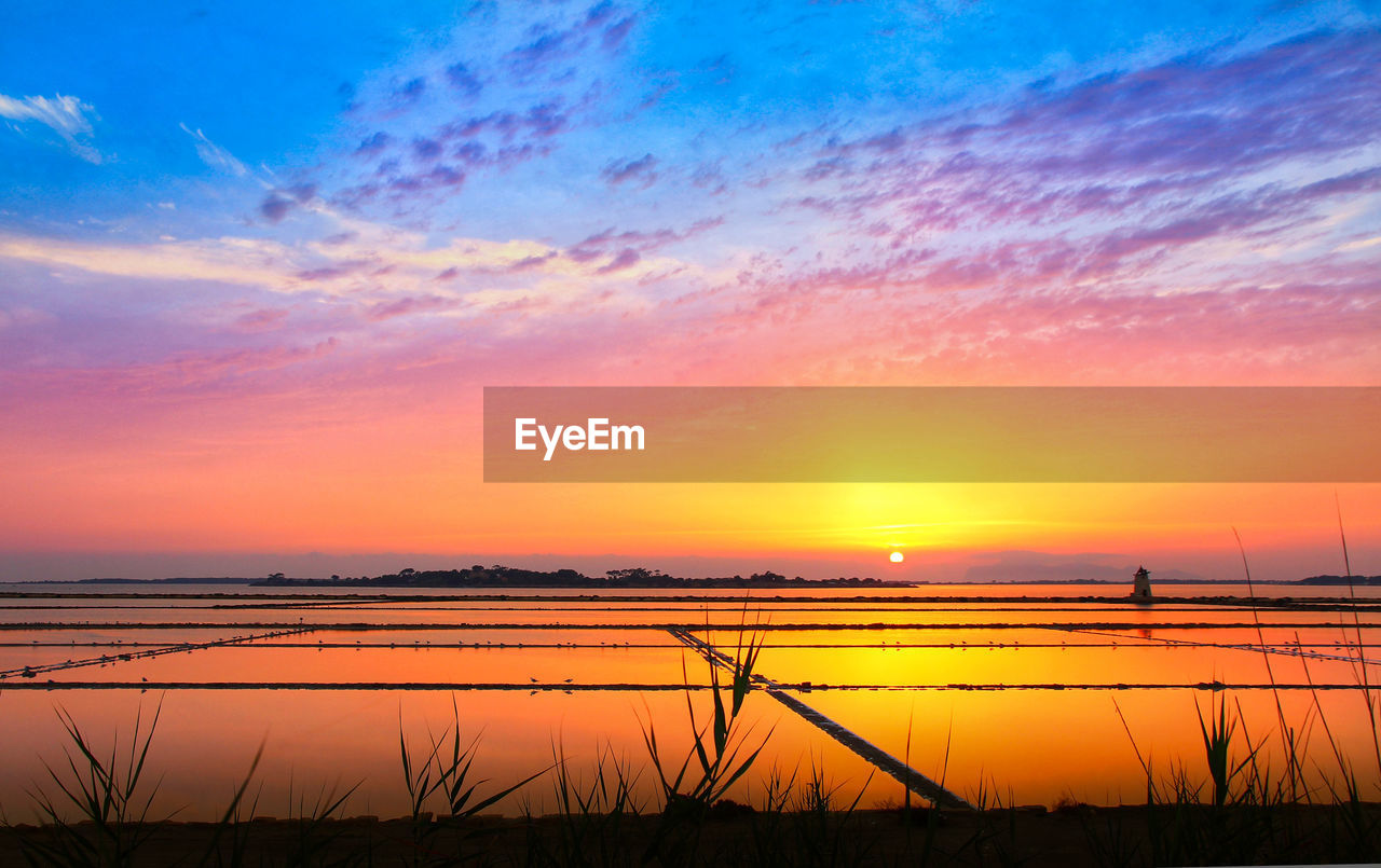 sky, sunset, beauty in nature, scenics - nature, orange color, tranquility, tranquil scene, cloud - sky, water, no people, idyllic, silhouette, nature, sun, lake, non-urban scene, outdoors, landscape, rural scene, romantic sky