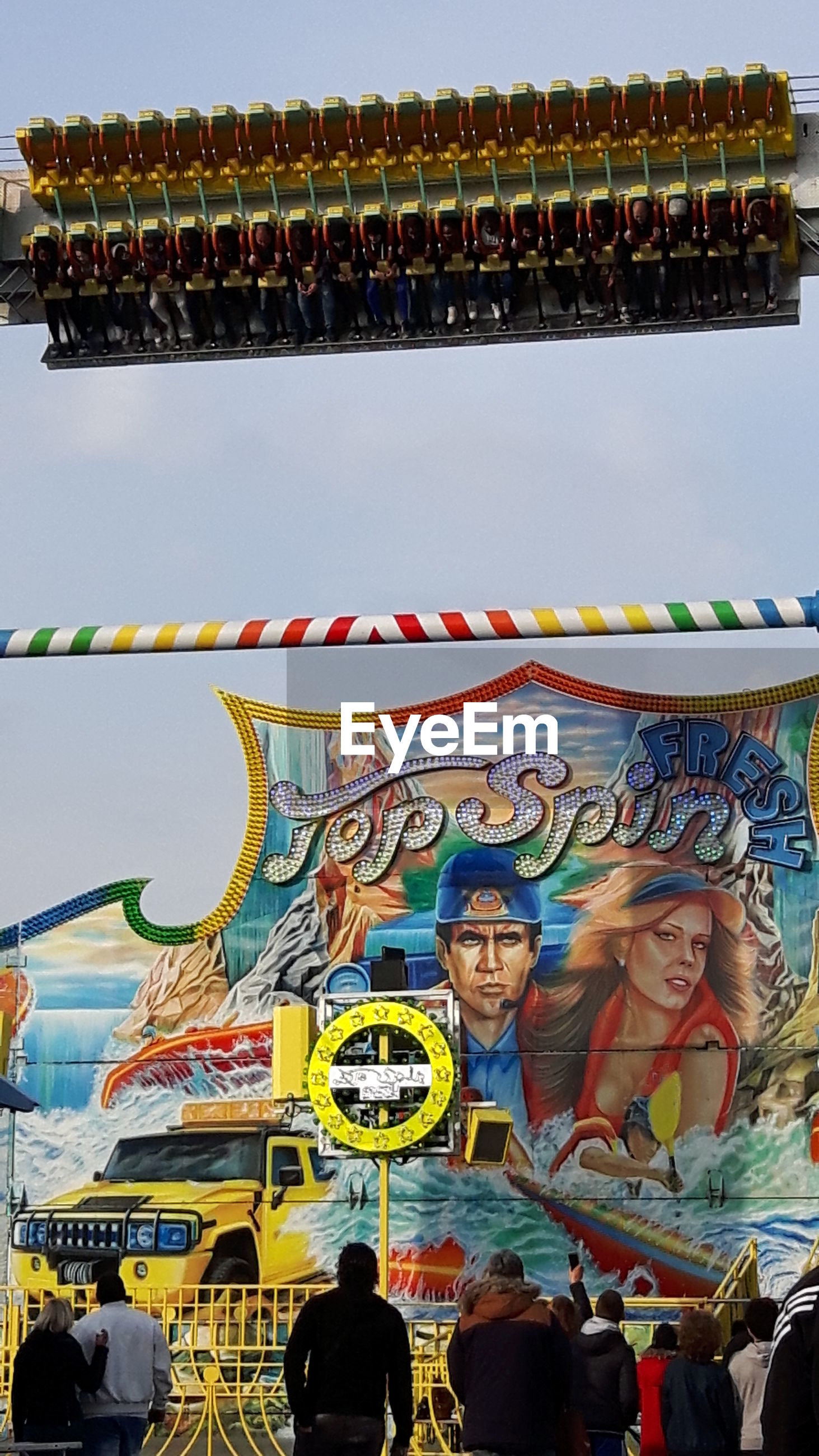 multi colored, art and craft, art, large group of people, creativity, lifestyles, leisure activity, men, cultures, person, built structure, architecture, sky, human representation, outdoors, arts culture and entertainment, day, low angle view