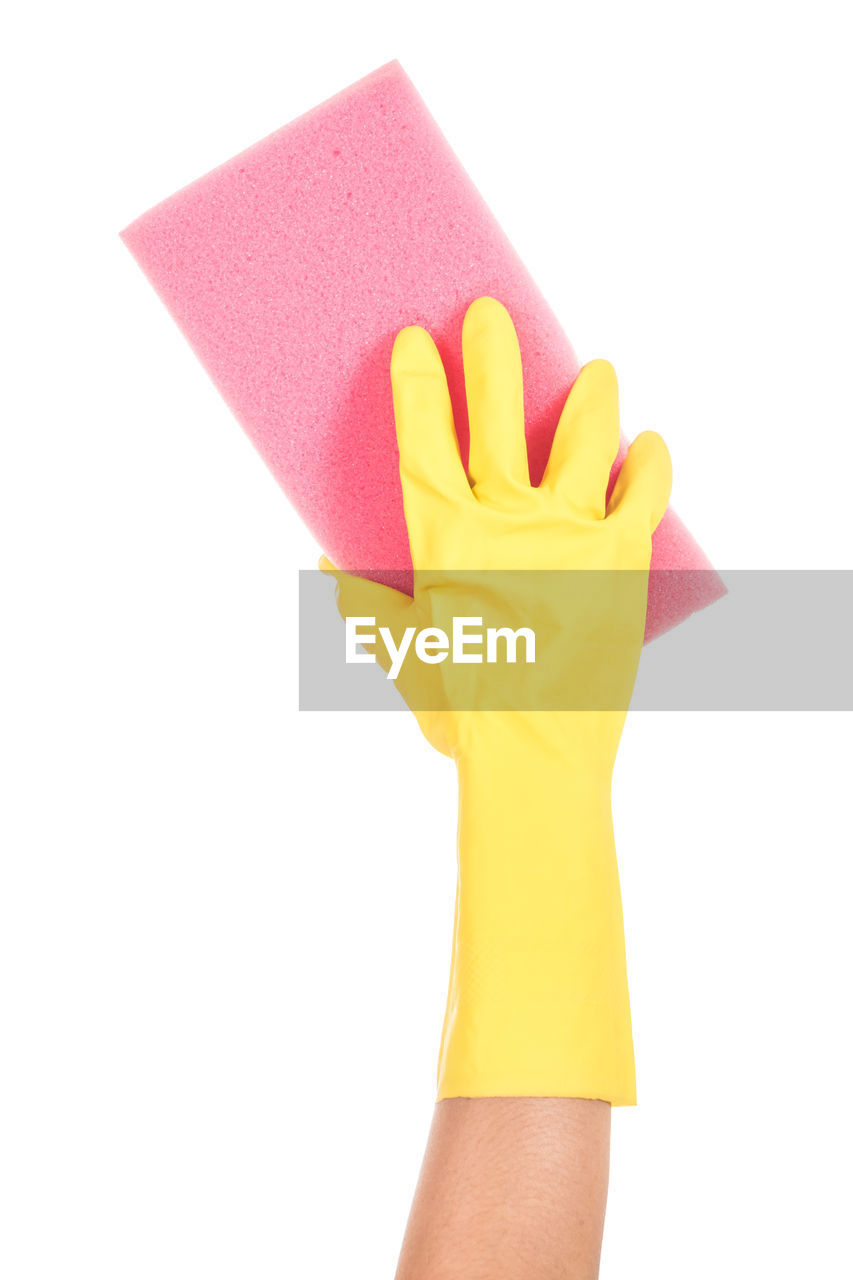 Cropped Hand Holding Napkin Against White Background